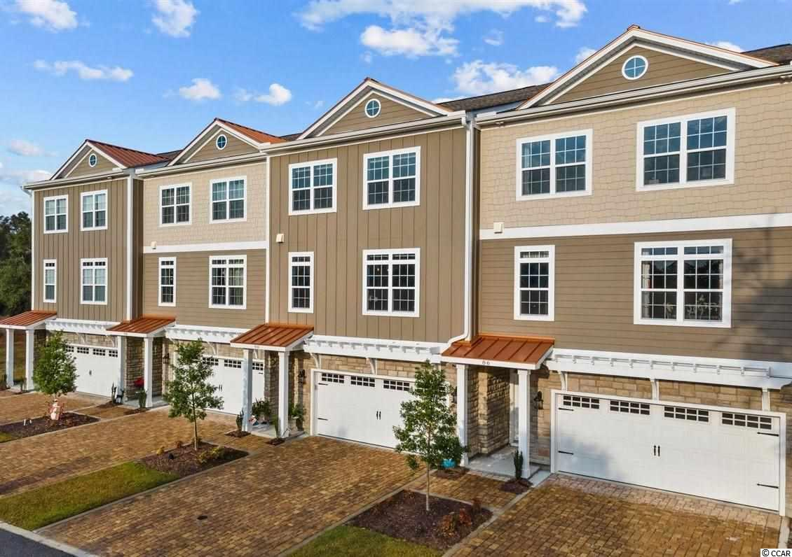 "Wonderful opportunity to own in the heart of Murrells Inlet. Located just across from the salt marsh in the gated community of Majestic Oaks, this 3 bedroom 3.5 bath luxury town home was built in 2019 and has it all: open floor plan, elevator, gas fireplace, 2 wet bars, walk-in extended master bath shower, Rinnai tankless water heater, soft close cabinetry, decorative five panel doors, fenced backyard that backs to woods, irrigation system, Levelor remote control window treatments, 2 car garage with abundant storage, screened porch, all appliances - including washer and dryer - are less than 8 months old. This quiet community boats plenty of guest parking and a resort like pool. From this prime location, you are just steps to fresh local seafood, less than .5 miles to the famous Marsh Walk row of restaurants and just a 4.5 mile bike ride to the Hunting Beach State Park. Truly a ""must- see""!"