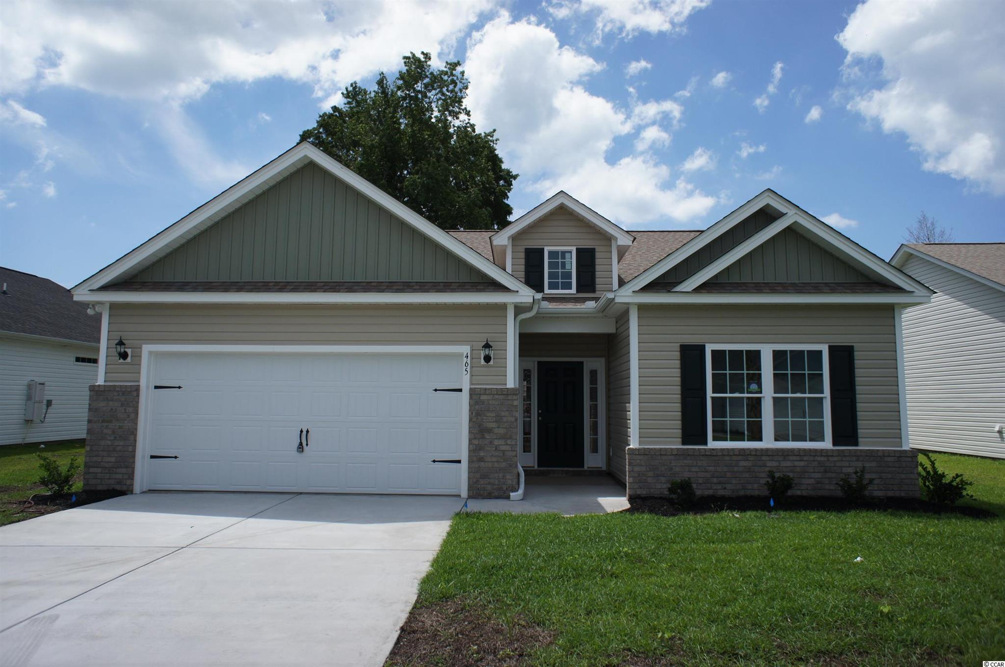 Beautiful Hatteras floor plan in the new Ocean Palms community. This terrific open floor plan, 3 bedroom, 2 full bath home will come with upgraded waterproof LVP flooring under an upgraded live dormer entryway and soaring vaulted ceiling in the family room, kitchen and dining area, and comfortable carpet in the bedrooms. Stainless appliances, staggered-height white painted birch cabinetry and a convenient granite breakfast bar combine to give you the wow factor you're looking for, and abundant recessed lighting plus two large windows in the adjacent dining area flood the room with light. A French door in the great room leads to the covered rear porch and the large separate patio beyond. The spacious master retreat features a long grey painted cabinet vanity, an oversized walk-in shower, plenty of storage in the linen closet and a huge walk-in closet, plus a tray ceiling. Two additional bedrooms and a full bath are tucked off on their own hallway, for privacy. All of the homes in Ocean Palms come standard with the luxury of natural gas (tankless water heater, gas heat, and gas range). The two car garage is completely trimmed and painted, and a floored attic storage space is accessed by drop-down stairs. Ocean Palms is conveniently located near shopping, restaurants, schools and world class medical offices and hospitals, and only a short golf cart ride to Surfside Beach's gorgeous beach and the beautiful Atlantic Ocean. Other floor plans and inventory homes may be available, and CUSTOMIZATION OF FLOOR PLANS IS POSSIBLE!!! Community Pool and Cabana are now open! Photos are of a completed, similar home and may have different features.