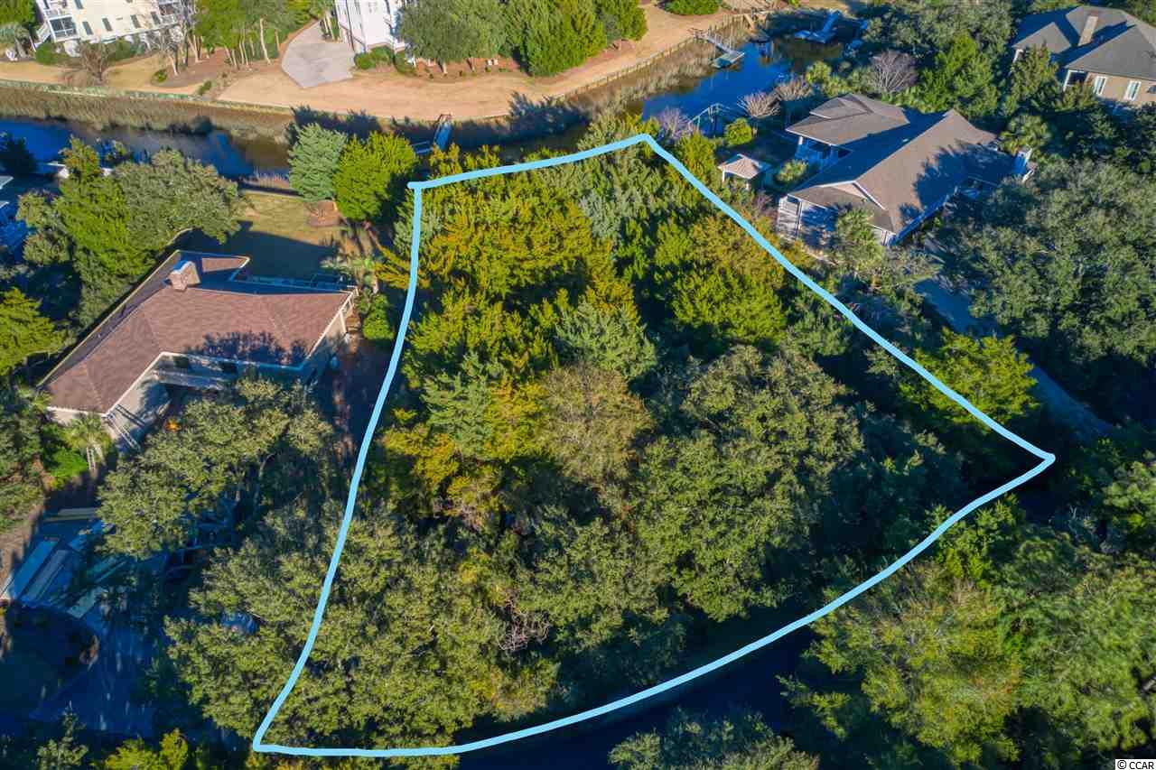 """South End creek lot in Debordieu Colony, one of South Carolina's most desired Private Coastal Neighborhoods. This homesite will give you access to Debordieu Creek where you can enjoy boating and fishing, sight seeing and fun for the whole family. Lot is over 3/4 an acre, with approx 50 feet of creek frontage. You will find this development the perfect picture of """"Lowcountry Living."""" Enjoy a short golf cart or bike ride to the Debordieu Beach Club and Pool. Debordieu owners have access to several types of memberships within the club including Championship Golf, Tennis, and Fine Dining. Imagine designing that coastal beach home you always wanted, in your new community call Debordieu."""