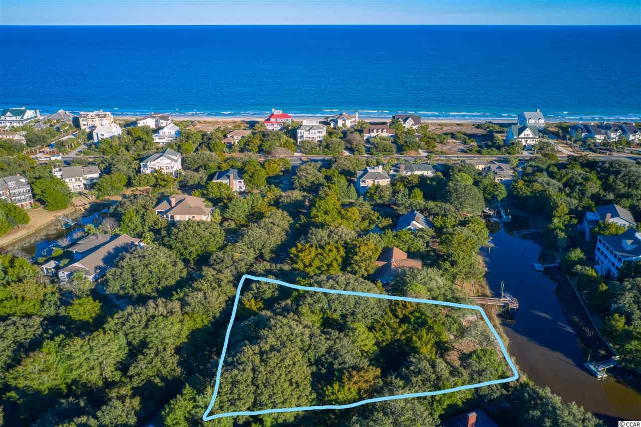 """South End creek lot in Debordieu Colony, one of South Carolina's most desired Private Coastal Neighborhoods. This homesite will give you access to Debordieu Creek where you can enjoy boating and fishing, sight seeing and fun for the whole family. Lot is approx 3/4 an acre, with approx 110 feet of creek frontage. You will find this development the perfect picture of """"Lowcountry Living."""" Enjoy a short golf cart or bike ride to the Debordieu Beach Club and Pool. Debordieu owners have access to several types of memberships within the club including Championship Golf, Tennis, and Fine Dining. Imagine designing that coastal beach home you always wanted, in your new community call Debordieu."""