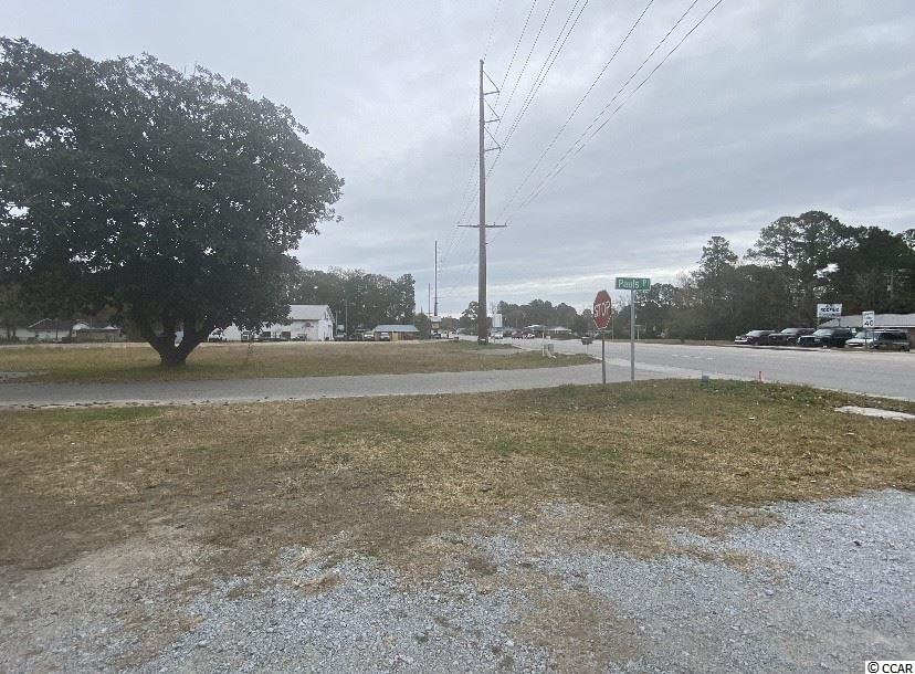 Beautiful, large 1.4 acre piece of commercial land! Corner lot located between Pauls Pl and Socastee Blvd. Located near Market Commons and busy traffic area.  Measurements are approximate and not guaranteed. Buyer responsible for verification.