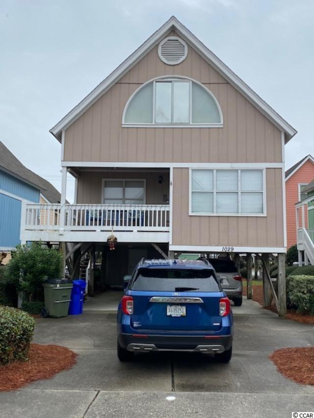 "3 Beds 2 1/2 bath Raised Beach House across the street from the Ocean, located in Surfside Beach, ""The Family Beach"".  No need to pack up the family car with this one! Walk across the street and enjoy all the sun and fun! Close to restaurants, bars, and entertainment, golf, shopping, airport and more! Sea Bridge is a well maintained community and includes cable, internet and pool. Downstairs master bedroom and bath, and open concept family and dining room along with an additional 1/2 bath. Upstairs has two additional bedrooms, 1 with an extended sunroom, currently fitted with extra sleeping quarters for larger families or guest, and the ability to accommodate larger groups as it's short term renter friendly! Off the kitchen you will find the included washer and dryer. Roof replaced 2017, new HVAC 2018.  Don't let this furnished price to sell home get away! Schedule your appointment today!"