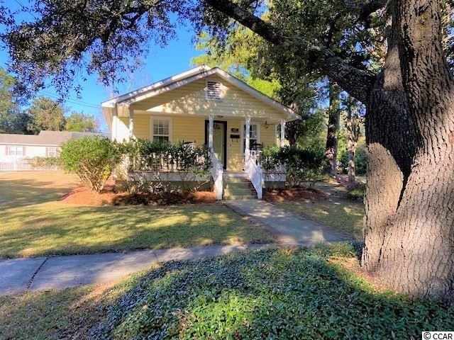 Little gems like this one in the Historic District don't become available very often!  Whether you are looking for a primary residence,  a weekend cottage, or investment property, this is a great opportunity to own a piece of the historic district and all of the perks that go with it.  You can walk or bicycle to the downtown shops, restaurants, & boardwalk on the river. Aside from that, you don't have to drive far for the essentials.  You are within three miles of grocery stores, pharmacies, the hospital, the post office, and a number of churches.  The inside of this house has been completely renovated. The rooms are all a generous size making good use of the square footage.  The front porch & the large deck in the back add outdoor living space & charm.  It you have been waiting for something like this to come on the market, don't miss this one.  It won't last long!