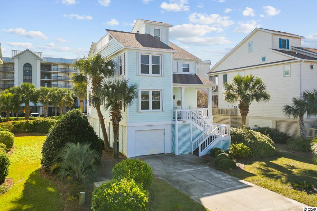 Location, Location, Location! Absolutely Gorgeous Pawleys Island Beach Home just hit the market in the exclusive Litchfield By the Sea Community! Just a stone's throw to the popular Litchfield Beach, this beautiful coastal home features 4 bedrooms, 3 bathrooms and 2,200 sq ft of indoor living space. Outdoor living space is hard to rival with the massive Captain's Deck at the top of the home providing water views on all four sides of the home! If that wasn't enough, this home boosts a massive porch off of the dining and living room space, a front porch for your rocking chair needs and two more balconies! The home is located in the sought-after Rookery Subdivision placing it among the few with a Lake View to the front of the house and still positioned just one block from the beach. This abundance of outdoor space will have your vacationers coming back year after year with enough space to comfortably house 8 guests at a time. The floor plan features a beautiful updated kitchen, a massive dining room onlooking one of the patios, a spacious living room, a massive master suite and very spacious bedrooms on both levels. The kitchen comes equipped with stunning granite counter tops, stainless steel appliances, plenty of counter space, and a bar for visitors. This amazing coastal style also boasts a split bedroom and bathroom layout for the convenience of beach vacationers or large family gatherings. During the summer, entertain in style on one of the many decks or relax near the sparkling resort pools or head to the beach. This home also comes equipped with a multi car garage and a massive driveway for plenty of parking space. All furniture, appliances, and furnishings to convey with purchase of the home! This is a must see for a growing family or exclusive rental property. Only a few miles from the Murrells Inlet Marshwalk and located in the highly coveted Litchfield By The Sea-It won't last long. Call today to schedule an appointment to come see it!