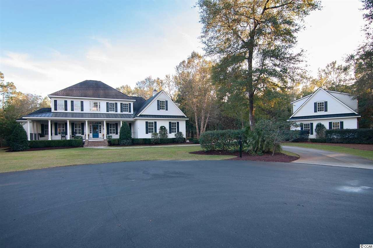 55 Butler Property - Low Country living at its finest! One of the most exclusive, private, gated Communities located on the Waccamaw River in Pawleys Island, SC: Don't miss this unique opportunity to call Allston Bluffs home!  Buyer Agents Welcome - Seller is amenable to signing a one time showing agreement for the subject property and paying up to 3% at closing if the Company's / Agent's registered buyer buys.  A Stately, Custom-built Low Country home situated on Estate Lot with ultimate privacy. Beautifully landscaped property with majestic oaks that provide a tranquil entry into this custom home featuring: heart pine floors throughout, Gourmet Kitchen, 2 fireplaces, tiled bathrooms, detached two-story building, deeded, deep-water Waccamaw River boat slip.    First floor Master Bedroom Suite with Master Bath that includes walk in rain shower, separate garden tub, double, separate sinks and vanity area, sizable walk-in closet and private entry rear porch. Spacious and open Gourmet Kitchen with custom cabinets, gas stove top & griddle, double oven, dishwasher, granite counters, professional chefs work island, breakfast bar with wall-of-windows overlooking the back porch / yard. Family Dining nook. Family Room with fireplace overlooking screened back porch and yard. Private Library / Study overlooking front and side yard. A Butler's Bar with built-in drawer dishwasher & wine cooler is strategically placed in between the Living Room with fireplace and Formal Dining Room. Well-appointed Powder Room. Garage-side family mudroom entry. Laundry room with prep sink, cabinetry, in-wall ironing board and storage space.  Second Floor: 3 sizable Bedrooms upstairs with 2 full baths, media / game room and plenty of walk-in storage.   Outdoor Fire Pit gathering area. Front & back open porches surround the home. Screened back porch. Grilling patio w/ Pergola. Attached 2 Car Garage. Crawl space encapsulated. Lawn well sprinkler system.    Other: Media control closet. Inside-Outside Speakers System. Rinnai tankless water heater. 3 zone HVAC system. Solid wood doors. Triple crown moldings. Central Vacuum System, Security System, Window blinds / shutters.  Detached, 2 story 1,358 sq ft structure with 168 sq ft covered porch easily converted to guest cottage, entertainment / summer kitchen, other.   8,390 sq ft  Under Roof  Conditioned Space in Main House: 5062 sq ft Screened Porch: 227 sq ft Covered Porches: 951 sq ft Attached Garage: 624 sq ft