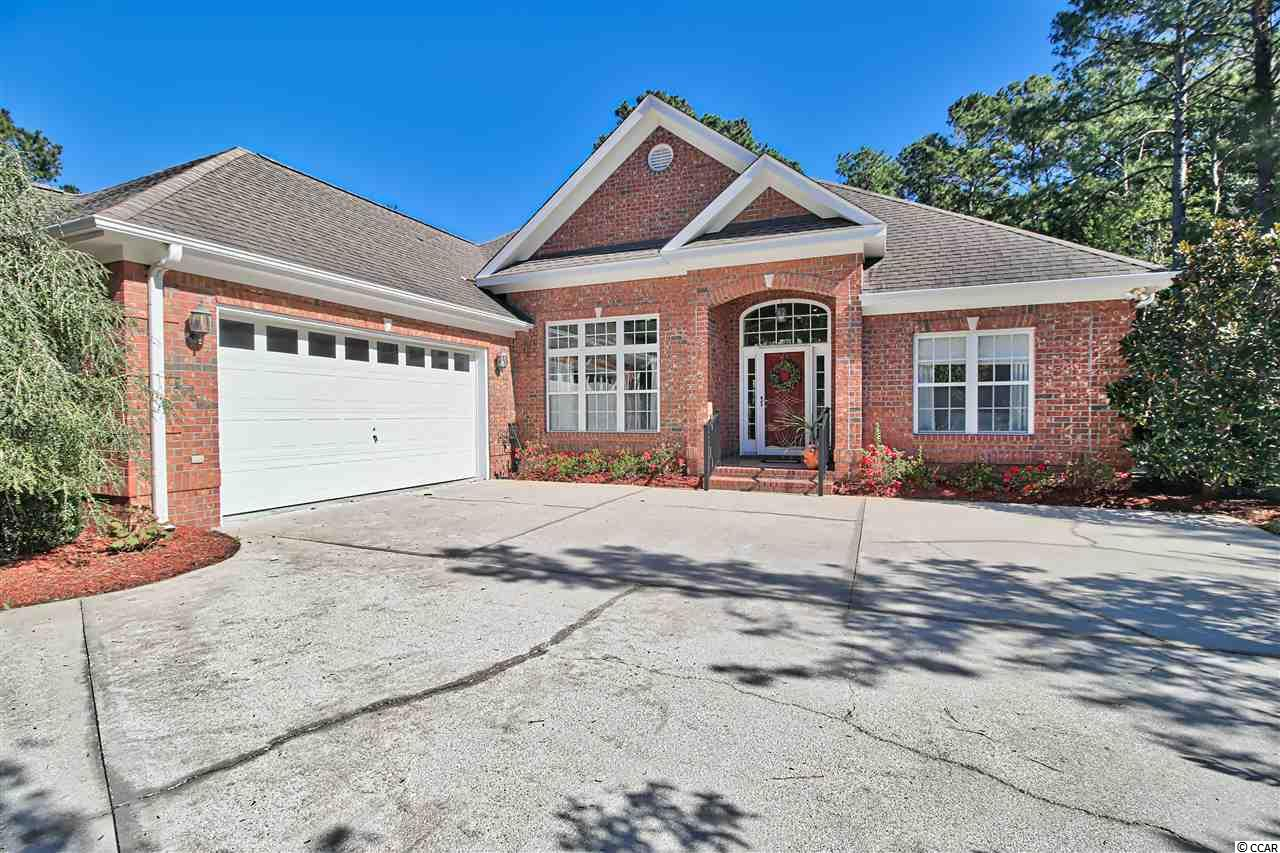 This immaculate all-brick 3 bedroom 2 bathroom home located in the prestigious community of Pawleys Plantation has everything you are looking for! When you walk into this home you are in awe of the open plan living and amazing views of the well-manicured landscaping and lush greenery in the yard. The kitchen features granite countertops, stainless steel appliances including a dual zone oven and breakfast bar with the option of installing a gas stove as it is already plumbed for gas.  The gas fireplace in the living room, built-in bookcases and open concept makes this one of the most comfortable and welcoming rooms in the home.  The spacious master bedroom has its own bathroom with garden tub, vanity, storage and shower with glass door. The true stars of this home are the two Carolina room additions and den area overlooking the yard and tranquil woods.  The Carolina room has vinyl windows and an indoor gas chimney making it perfect as an all-season living space. The security system conveys with the sale as well as the option for the golf and club membership.  Just a few minutes from the beach and amenities such as the Pawleys Plantation Golf and Country Club, outdoor pool, tennis courts, clubhouse and a Jack Nicklaus Signature Golf Course make this home particularly appealing!  Schedule in your showing today!