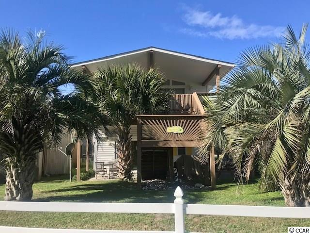 WOW! ONE STREET BACK FROM BEACH WITH PEAK OCEAN VIEW!  Enjoy your mature palm trees from your covered deck or              hang downstairs on your patio with yard space for corn toss.  Tons of possibilities. 2ND home or rental property ?  SUPER CLEAN and Freshly painted through-out.  NO MORE POPCORN ! Ceilings scraped 2020 ... super nice update!  Home in nicely decorated, kitchen is stocked, newer ceiling fans,         newer MATRESSES,  TONS OF STORAGE.                                                                   PRIVATE INTERIOR ROLL DOWN DOOR STORAGE AND 2 GARARGES  Efficiency room downstairs with full bathroom.  Conveys furnished.  Bank Financing Available.