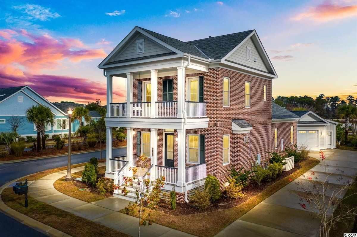 Welcome to a luxurious, coastal lifestyle in this beautiful, like new 3 bedroom, 2.5 bath, meticulously maintained home in the Living Dunes, a quaint section of the Grande Dunes which is a Natural Gas and Smart Home community located just a 1/2 mile from the beach.  Upon arrival you'll see this home absolutely oozes Southern Charm, the all brick two-story Charleston style stacked double porches give you the perfect spot to relax and enjoy the sunset.  You'll be welcomed into the spacious bright and airy living and dining room area which offers a vented gas fireplace and don't miss the extra large storage closet, then onto the kitchen which highlights custom cabinets, granite countertops, and stainless steel appliances.  Master suite on the main floor has a tray ceiling, ceiling fan, walk in closet and a large tiled shower with a frameless glass door. Upstairs, you will find 2 generous bedrooms both leading out to a shared balcony.  The inviting paver patio with outdoor kitchen including built-in natural gas grill is perfect for all your entertaining. Lastly, is the detached one car garage that also comes with a golf cart garage.  These homes are built with higher grade materials which allow you to own a quality home that is energy efficient and eco friendly. The community offers it's own beautiful on-site amenities including clubhouse, pool, kiddie pool, walking trails, lakes, sidewalks, putting greens and gathering areas with firepits. Also in your HOA you're just a 1/2 mile golf cart ride to the private Grande Dunes Ocean Club where you can enjoy the beautiful beach, pools and restaurant.  You can't go wrong with this LOCATION and LUXURY!