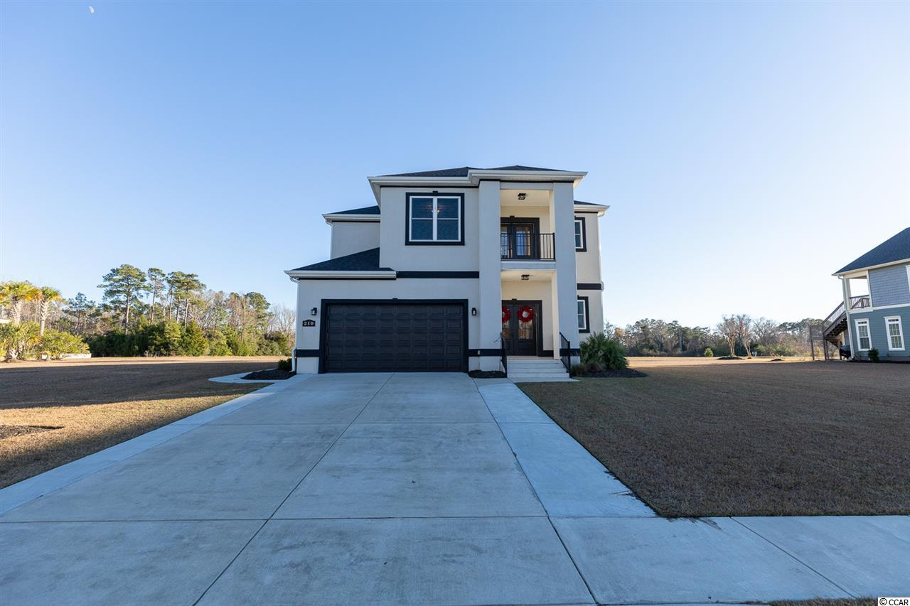 What a rare opportunity to own this gorgeous 3 Bed 3.5 Bath home in the serene Palmetto Harbor on an Intracoastal Waterway community, in the heart of North Myrtle Beach. This home features an open floor plan featuring a stone fireplace that will take your breath away. The kitchen has white granite, gray cabinets with gold hardware. This home offers Wood flooring throughout most of the home. The first floor master bedroom is spacious and has an alluring view of the pond. The master bathroom has a dazzling shower, double sinks and a vanity in between. The second floor has an open study with built-ins. There is a breathtaking view of the Intracoastal Waterway from the second floor balcony. Enjoy the large fenced in yard while you relax in the screened in porch over looking the massive pond behind the home. One of the few lots that has a view of the waterway from the second row. Palmetto Harbor is centrally located near everything, ride your golf cart to the beach or head on over to Main St. for dining, shopping and so much more. This home truly has it all and will not last!