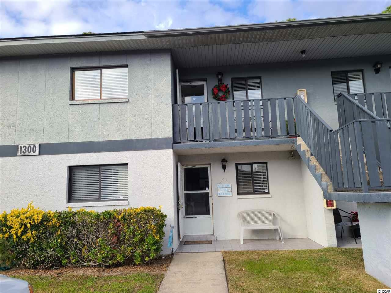 Pack your suitcase and move right into this fully furnished and stocked 2 bedroom 2 bath condo in the quiet Tradewinds I neighborhood of Surfside Beach. Maintenance free living with low HOA dues that cover water/sewer, trash, recycling, cable tv, internet, all landscaping, exterior building insurance, pest control, and onsite pool.  This spotless unit is on the first floor and has been painted top to bottom, new HVAC unit in 2019, new hot water heater in June 2020, new laminate wood floors in great room, new light fixtures and ceiling fans throughout, new blinds on all windows, new screen on the porch, new lever handles throughout, new shower heads, new smoke detectors, and new cabinet hardware in kitchen and baths. All three beds and living room furniture were bought new in 2018 and have only been used a few times since this has been a second home.  All beach decor conveys as well so there is nothing left to do but enjoy the beach just a mile away, eat at a different fabulous restaurant every night, and have all the conveniences nearby such as grocery stores, banks, doctors, and entertainment. There is a stackable washer/dryer in the hall on the guest side of the condo as well as a linen closet. The master en suite includes a walk in closet, private full bath with spacious shower and is in the back of the condo overlooking a wooded area. The great room wall is floor to ceiling mirrors which adds a more spacious and bright atmosphere. Call today for a showing!