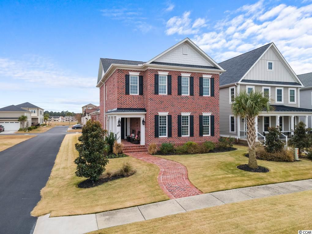 Custom all brick beauty in Waterway Palms Plantation...  Every square foot of this stunning Charleston-style home has been meticulously planned and boasts craftsmanship that truly sets it apart.  Each level of this immaculate home houses its own living room area; the upstairs living space is perfect for a playroom, office, media room or even a 5th bedroom.  Each of the 4 spacious bedrooms has an en suite.  Take note of the custom lighting throughout the home. The first floor master bedroom is large enough for a sitting area and office space!  The master bath holds a large tiled, walk-in shower, whirlpool tub and his and hers walk-in closets.  The stunning 9x5 custom-built island is the focal point of this home's massive kitchen.  The large pantry room is amazing with additional deep shelving to accommodate all small kitchen appliances. The immense mudroom is a large family's dream!  There is a brick wall in the side yard that has room for a pet, and houses the patio and grill area. The gorgeous coffered ceiling, and inviting hearth area and fireplace gives this family room the feeling of true warmth and comfort.  Another bonus to this home is the quaint Florida room, located off of the living room, serving as another entry into this spectacular home.  If storage is what you need, look no further - this home has a walk-in attic, as well as a pull-down attic, storage under the stairwell to store all of your holiday decor and coats, and walk-in closets in the bedrooms.  The yard boasts beautiful Zoysia grass, landscape lighting, and the home is equipped with a central vacuum system. Some home furnishings are negotiable.  Waterway Palms Plantation is a gated, Intracoastal Waterway community with boat storage, boat launch/docks, resort pools, playground, gym, tennis courts, and gorgeous clubhouse facility.  Your new home awaits - make an appointment for a showing today!