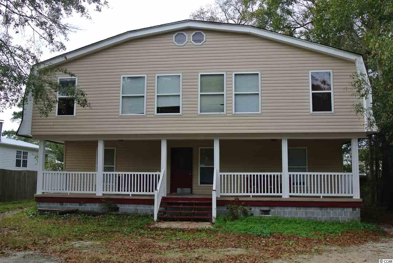 Previously used to house International Exchange students here through a work program.  Duplex upstairs and separate unit down stairs. East of Hwy 17 and just 3/4 mile to the beach!  You will not find a property like this so close to the beach at such a price!  This duplex is set up into two units upstairs and one down stairs.  Downstairs is comprised of a living room 4 bedrooms and 2 full baths and a full kitchen. Upstairs left unit is comprised of 2 bedrooms, den/kitchen, full bath and a bonus room.  Upstairs Right unit is comprised of 4 bedrooms, kitchen/den a full bath and hall to lockable door to downstairs.  NO HOA.  Located in unincorporated Garden City Beach-close to beach.