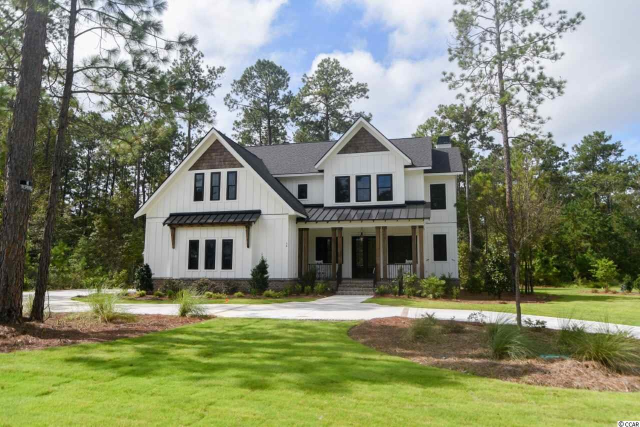 Stunning Modern Farmhouse in the Highly Sought After Collins Creek  Landing of Prince Creek.  Excellent Investment Opportunity with leaseback to builder for use through the Dec 2021. This Home is a Builder's Show Home.  Thoughtful Trim Details such as Shiplap and Oversized Trim Makes this a Standout!  Upgrades Throughout Include a Stunning Gourmet Kitchen with 5 Burner Natural Gas Cooktop and Wall Oven, Enormous Island for Entertaining. The Kitchen Flows to the Large Family Room with Vaulted Ceilings Adorned with Wood Beams and a Fireplace with Built-ins.  The Family Room Opens to the Screen Porch with Another Fireplace and Built-In Grill.  Features Include LVP Flooring on the Entire Main Level and Upstairs Loft, 10' Ceiling with 8' Doors, Designer Lighting and Colors Chosen By a Professional Decorator . The Gleaming Owner's Bath Features a Tiled Oversized Walk-In Shower, Free Standing Tub, Split Separate Sinks, and Tons of Cabinet Storage.  From the Custom Built Walk-In Closet you can Access the Laundry Room.  Upstairs is a Large Second Family Room and 3 Additional Bedrooms.  One of the Bedrooms Is Large Enough to be a Second Owners Suite or In-law Suite!  Living In Collins Creek Gives You Amazing Access to the Community Pool, Community Center, Day Dock and Landing to the Waccamaw River.  This Neighborhood is Close to Dining and Shops at the Marsh Walk, Minutes from Hospitals, 15 Minutes to MYR Airport, and an easy Day Trip to Charleston for Lunch.  The Central Location Makes this an Easy Place to Call Home.