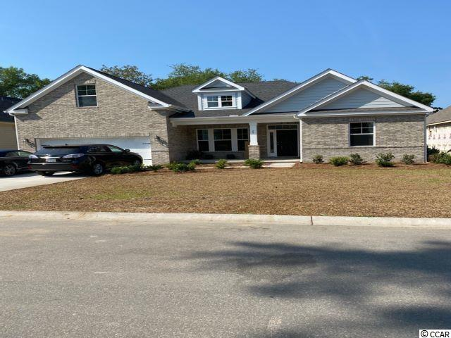 The wait is over for this new phase of Pawleys Plantation. This is a to be built plan with the standard features pricing that is ready for your input on the options and colors.  The home includes granite countertops throughout, 9 foot ceilings, crown molding and tall baseboards, lawn irrigation and much more! All measurements are approximate and can be verified by Buyers Agent/Purchaser. This home is a Carol B-4 model. Don't miss this opportunity to own the home of your dreams in Pawleys Plantation!
