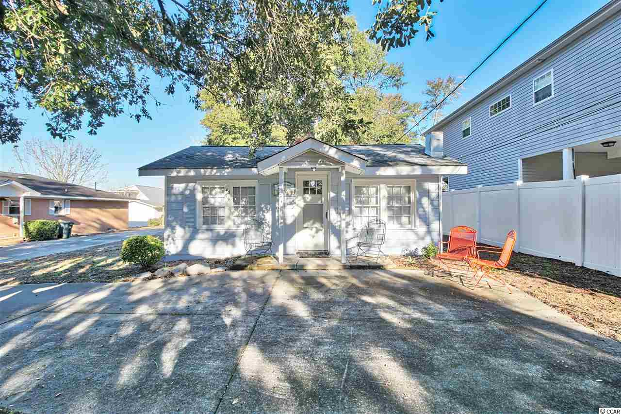 THIS COZY BEACHY BUGALOW COULD BE YOUR PLACE  AT THE BEACH! THE CUTE  1 BEDROOM 1 BATH IS  LOCATED IN THE WINDY HILL SECTION OF NORTH MYRTLE BEACH. HOME HAS TILE THROUGH OUT AND HAS A NEW  HVAC SYSTEM INSTALLED IN JULY OF 2020. THE EXTERIOR OF THE HOME HAS BEEN FRESHLY PAINTED. HOME SITS ON LARGE LOT (54X150) WITH LOVELY OAK TREES. SHORT GOLF CART RIDE OR 10 MINUTE WALK  TO WINDY HILL BEACHES AND THE BIG BLUE ATLANTIC. HOME IS CLOSE RESTURARANTS SHOPS GROCERY STORES AND BAREFOOT LANDING. SET UP YOUR SHOWING TODAY!