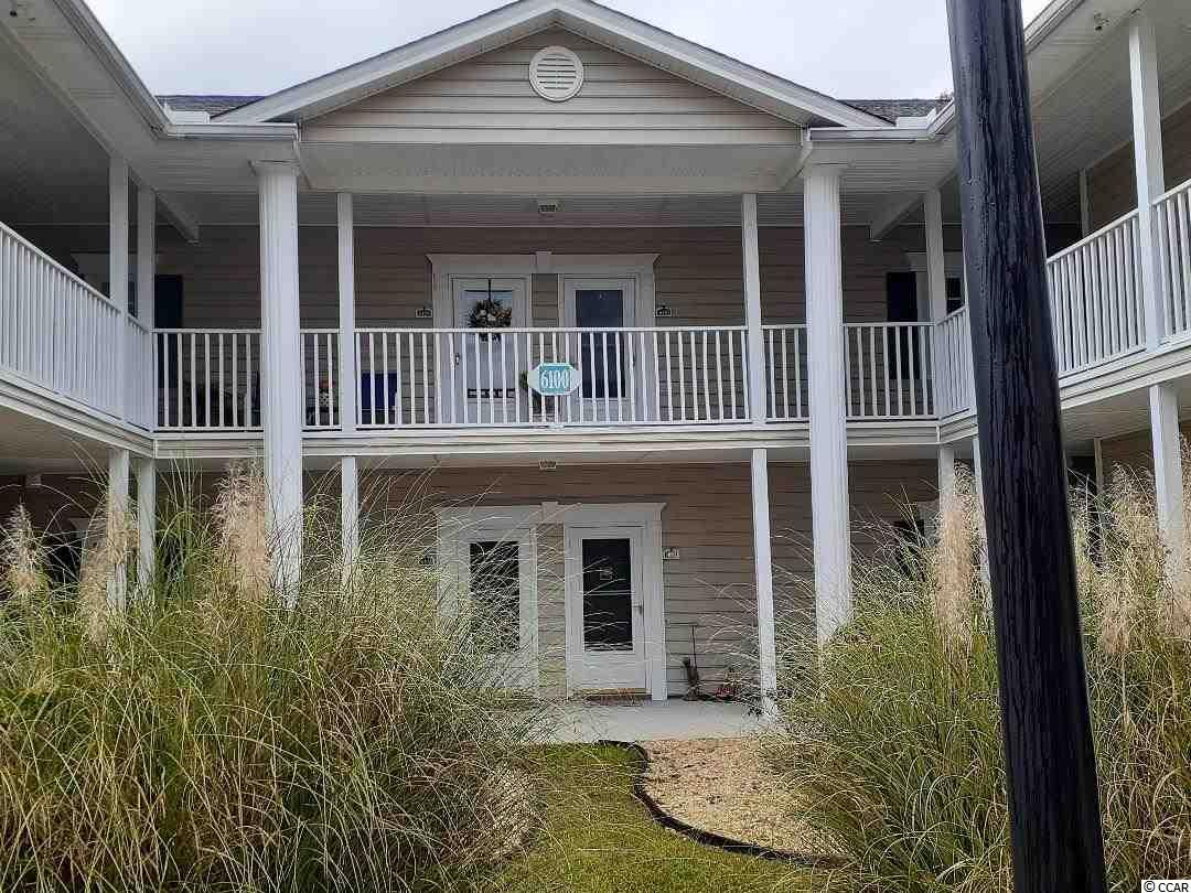 This is a well-maintained first floor unit in beautiful Sweetwater.  Convenient to everything Myrtle Beach has to offer!  Recent upgrades include:  grey laminate flooring,  granite countertops in kitchen, new garbage disposal, new stainless S/S refrigerator, paint, ceiling fans, and new stackable washer/dryer.  This is a 2BR/2BA split bedroom layout with sliding doors that lead to a large screened-in porch at the back of the unit.  There is an attached outside storage closet within the porch.  The porch is private with a view of the pond and one of the pools.  The kitchen has plenty of cabinets and beautiful new granite counter tops, undermount stainless sink, new stainless S/S refrigerator, smooth top stove, exhaust fan, dishwasher, and new garbage disposal.  Separate dining area is large enough for a table and 2-3 chairs.  Master bedroom has a walk-in closet and second bedroom has a large double closet.  Both bathrooms have a single vanity and tub/shower combo with vinyl surround. New stackable washer/dryer to remain.  New grey laminate flooring in living/dining area, vinyl tile in kitchen and baths, and carpet in both bedrooms.  Plantation blinds throughout.  This popular community has tennis courts and several pools available to all residents and the HOA includes everything but your electric.  This unit won't be available for long!