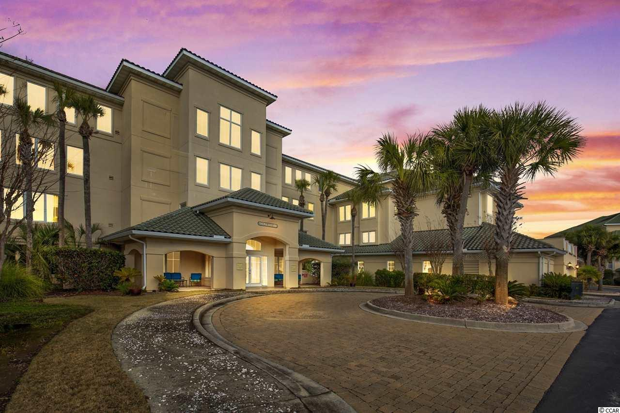 Welcome to Edgewater- A gated community within Barefoot Resort. This Furnished TOP Floor 3 bedroom/3 Bath END UNIT in an elevator building overlooks the Greg Norman Golf Course. This condominium offers a TRANSFERABLE GOLF MEMBERSHIP at a significantly reduced cost. The open floor plan allows for entertaining with great views from the kitchen to the dining room/living room area with a lot of windows for natural lighting. The kitchen has Maple cabinets with solid surface countertops . There are TWO Master Bedrooms in this condominium with walk in closets and on-suite Master baths offering a jetted tub w/stall shower and double vanities. There is a laundry room with a full size washer and dryer.  The screened porch has a tiled floor and ceiling fan with great views of the 15th fairway and green of the Greg Norman Golf Course. In addition, there are 2 storage units – one storage room located just outside the front door and another in the garage area. There is one assigned garage parking space with additional parking conveniently located outside the front of the building. The Edgewater community offers premier amenities including: a clubhouse, fitness center, hot tub, pool and deck, grilling area- All located along the intracoastal waterway. Enjoy watching the boats go by while swimming or exercising. Day docks are available for residents. Edgewater has a full time on-site manager and maintenance staff. Residents also have use of the new Barefoot Resort & Golf oceanfront cabana (which is currently under construction) and access to the Salt Water pool located at the North Tower. There is complimentary shuttle service to the beach during summer months. Barefoot has 4 signature golf courses, a driving range, and a luxurious golf clubhouse.  This location is close to Barefoot Landing, Alabama Theater, House of Blues, and restaurants and shopping. Come and Enjoy the Barefoot lifestyle!  Measurements are approximate and square footage should be verified by buyer.