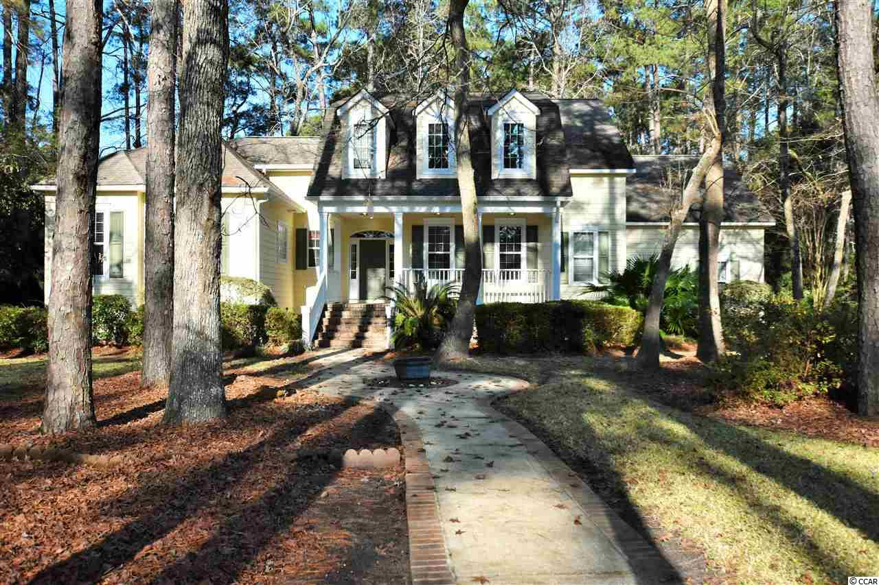 ** The Deadline to submit your best offer is Monday 1/11/2021 a 1pm   ** Lowcountry home boasting all the appeal of times past and thoughtfully designed to fit the elegance of Heritage Plantation. This home is loaded with southern charm. A welcoming front porch invites you to enter this well designed custom home. Boasting 4 bedrooms, 3 ½baths, formal dining with dental moldings. The living area offers soaring ceilings, fireplace with hand crafted mantel and floor to ceiling windows that surround beautiful French doors. The kitchen is the heart of the house. Rich wood cabinets, granite counter tops and stainless appliances are every cooks dream. The light filled breakfast rooms spills over into a charming screen porch with tiled floors and to the spacious deck with hot tub. What a perfect design for entertaining. Thoughtfully located on the first floor is the master suite. Large enough for a seating area and filled with light. The master bath has garden tub and spa shower. The master closet is an absolute dream! All of the other bedrooms are oversized and will make your guest never want to leave. The 3 car garage and outdoor shower offer additional benefits to make this one perfect! The captivating home at 74 Muirfield is situated on a generously sized estate lot with mature landscaping. Amenities at Heritage Plantation include golf, tennis, 75 foot pool, and a marina on the waterway.