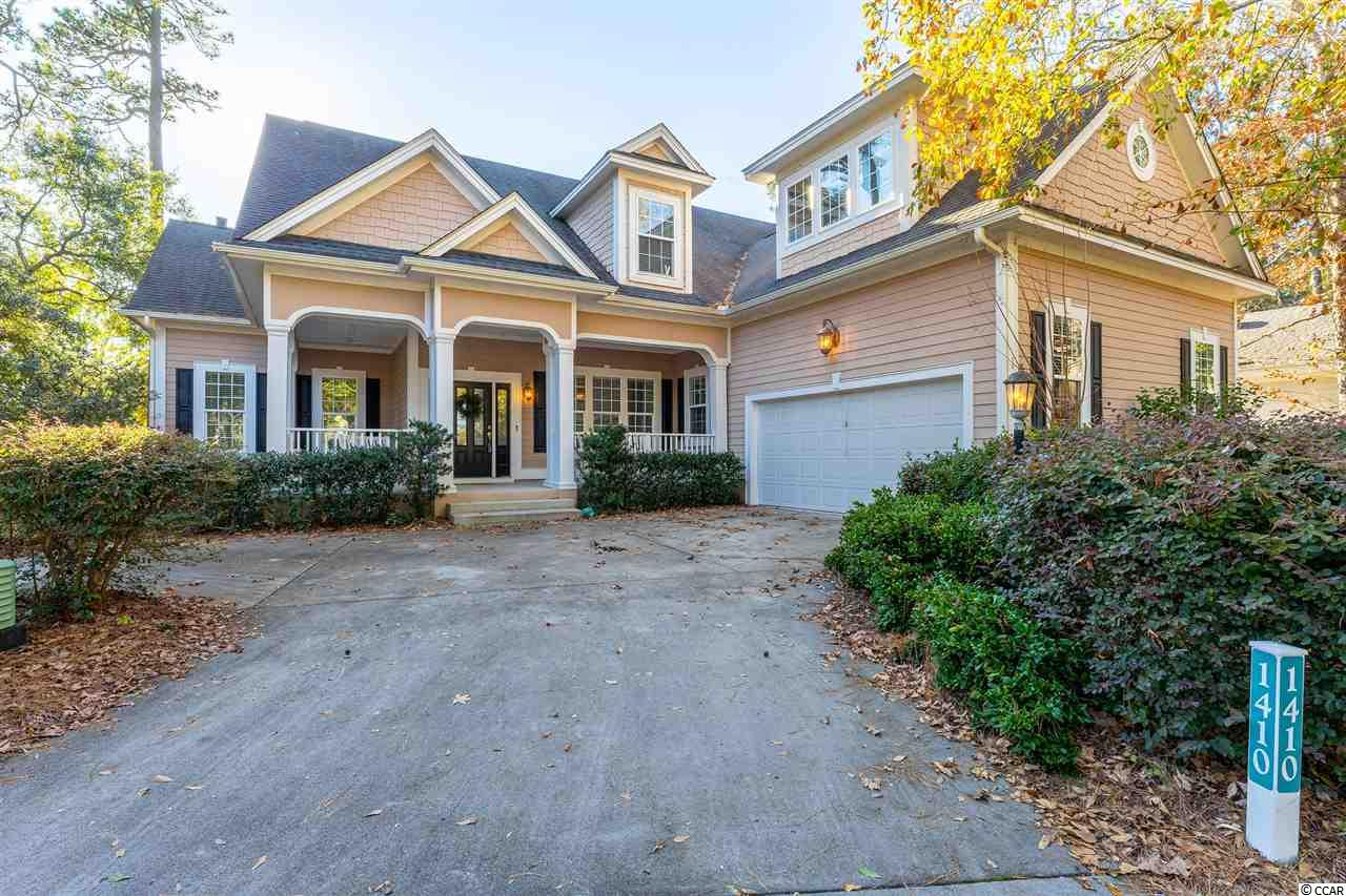 Long-time second owner reluctantly parting with impeccable, never rented Tidewater vacation home.  This top-of-the line, custom-built luxury home is professionally furnished and decorated.  All furniture and contents are negotiable! Timing is everything, and this is your moment: Just move in! This spacious Tidewater Plantation Resort beach house with traditional wrap-around, Southern-style front porch is immediately inviting. It boasts a private, lightly wooded unique location on one-and-1/2 lots and on the signature 7th hole of world-class Tidewater Golf Course, along with a pretty, 75'-road-frontage-presentation that also allows a nice driveway and a big, side-load garage. No close neighboring homes visible from that front view.  Enter into a beautiful entry foyer, overlooking the heart of the home, the magnificent great room with fireplace, surround shelving & cathedral ceiling. Look straight through the wall of windows to the screened porch and on to the golf course. Much natural light throughout to enjoy, too! To the right is a first-floor open office, study of just flex space to personalize. Ahead and to the right is the informal dining area seating eight off the great room and adjoining the magnificent upscale kitchen. The luxury kitchen has it all, plus breakfast bar, work desk, granite countertops, stainless appliances, walk-in pantry, more. Most closets are walk-in, and there is much planned storage on both levels. The master is off the kitchen on the main level. It has a peaceful, secluded patio, tray ceiling, large walk-in closet & shower, separate vanities & water closet.  Nearby is a half-bath for guests, fully equipped laundry room with soaking-sink and a convenient rear entry from the garage directly to the kitchen. The big garage has a separate door to the yard and a defined workshop area. An upstairs with dual-access to the front foyer or to the kitchen is simply unbelievable! There are two huge bedrooms, two full baths, an enormous bonus room, add