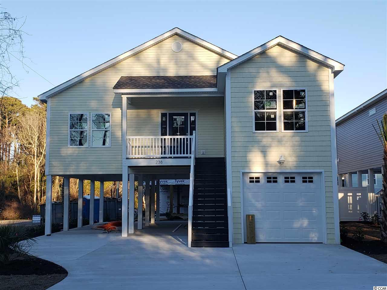 4BR / 3BA new construction raised beach home 2 blocks from the ocean in the Crescent Beach section of NMB. - Home to feature : 9 & 10' ceilings, crown molding, granite countertops in kitchen and baths, tile shower and double vanity in master, full appliance package, concrete drive and fully landscaped yard. Great floor plan with large bedroom and bath on ground floor with interior staircase.