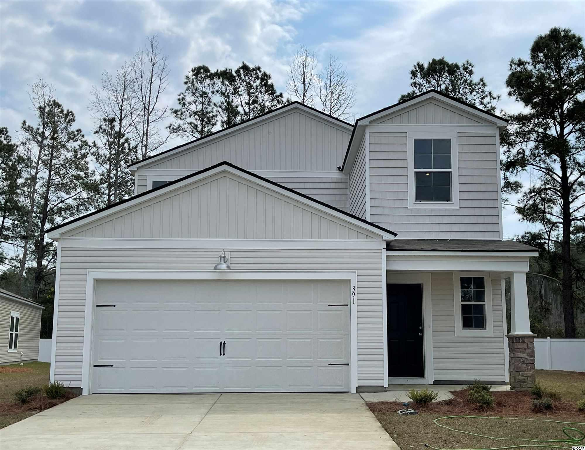 """Under construction - Ready March 2021. The Columbia is a Two Story floor plan that features 5 bedrooms, 2 bathrooms and a Powder Room, The Owners Suite is located on the ground floor, which includes a spacious Master Bath and an oversized walk in Closet. The Owners suite bathroom features double sinks an elevated vanity and a 5' shower. This open concept home hallmarks 36"""" stylish white cabinets, a 3 x 6 subway tile back splash in the kitchen, granite counter tops in the kitchen, Shaw laminate flooring in the main living areas, GE  Stainless steel appliances including a Gas Range, Microwave Range Hood, Dishwasher, and Disposal.  This home also features LED recess lighting, Moen faucets and towel hooks, elongated toilets with soft close lids, a Rinnai tankless gas water heater, and automatic garage door opener. Pictures are of a previously built home that may have additional upgrades and are for illustrative purposes only."""