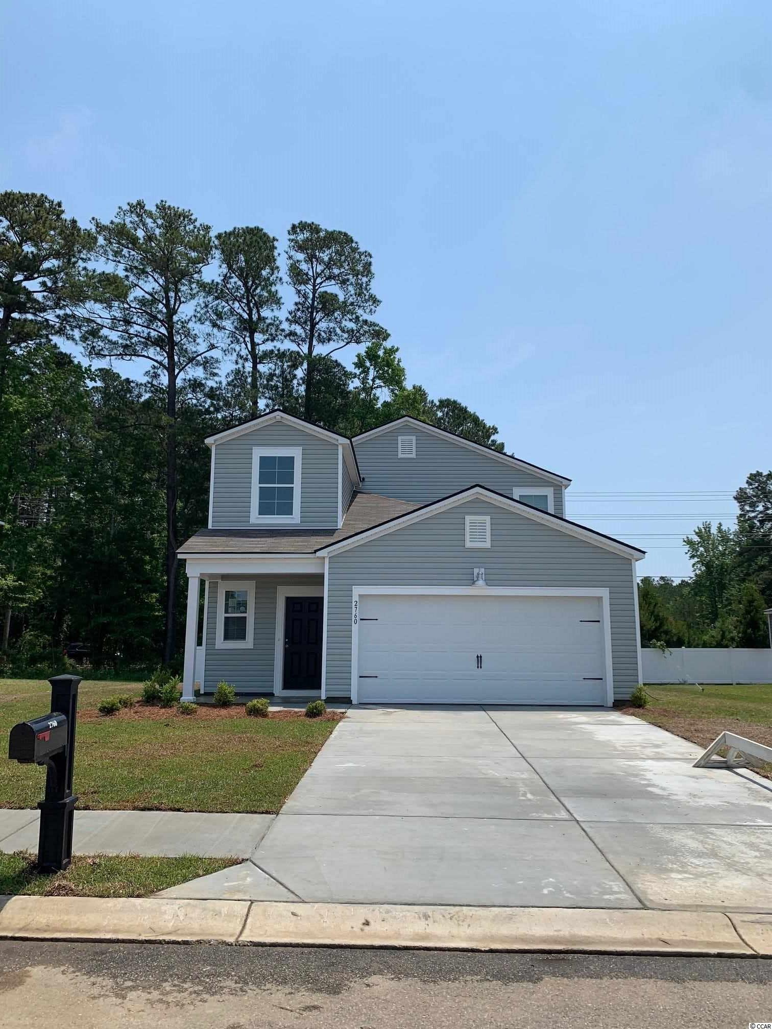 """Ready in April.  The Columbia is a Two Story floor plan that features 5 bedrooms, 2 bathrooms and a Powder Room, The Owners Suite is located on the ground floor, which includes a spacious Master Bath and an oversized walk in Closet. The Owners suite bathroom features double sinks an elevated vanity and a 5' shower.This open concept home hallmarks 36"""" stylish white cabinets, a 3 x 6 subway tile back splash in the kitchen, granite counter tops in the kitchen, Shaw laminate flooring in the main living areas, GE  Stainless steel appliances including a Gas Range, Microwave Range Hood, Dishwasher, and Disposal.  This home also features LED recess lighting, Moen faucets and towel hooks, elongated toilets with soft close lids, a Rinnai tankless gas water heater, and automatic garage door opener. Pictures are of a previously built home that may have additional upgrades and are for illustrative purposes only."""