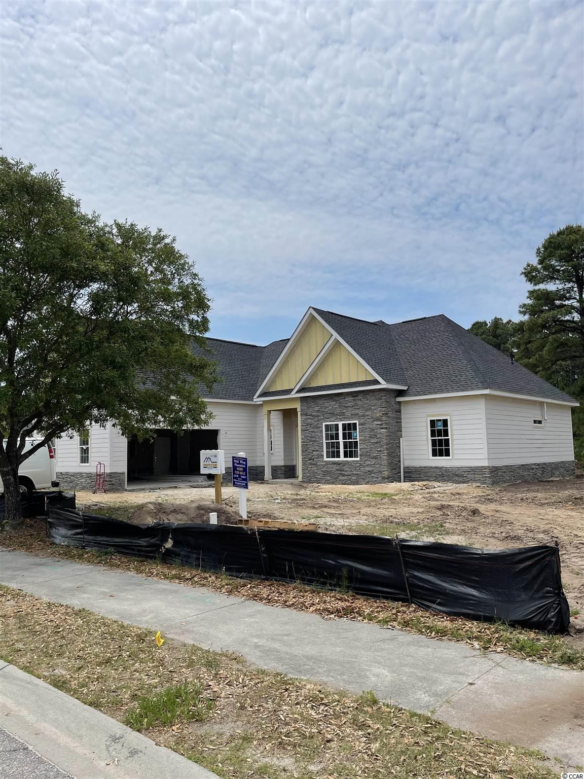 This beautiful new construction home is under construction and will be ready for a lucky buyer in June 2021! Located in the Wild Wing Plantation community that has a World class golf course and an amenities center that is amazing!. As you will enter this perfectly laid out open floorpan home with 4 bedrooms 3 bathrooms and a 5th room perfect for an office on the first floor. You will notice right away the upgrades and quality of work are above and beyond other larger builders in the area. This is a 100% custom home and it shows!. With LVP flooring throughout, Hardie board siding, upgraded countertops, tankless gas water heater, soft close all wood cabinets, all showers are tile including a large shower and tub in the master bathroom, custom wood shelving in your oversized master walk in closet, large tray ceilings, appliances credit will be given, crown molding and upgraded lighting package. This is a large private lot with woods/water access to the large lake in Wild Wing. Community has two entrances/exits which makes for easy access to all shopping, restaurants, medical facilities, Coastal Carolina University and two Highways for a quick drive to anywhere on the beach!. Buyers if purchase in time will be given choices for certain finishes. Pictures are of a completed similar home in the community. Book your showing today as you will not be disappointed!