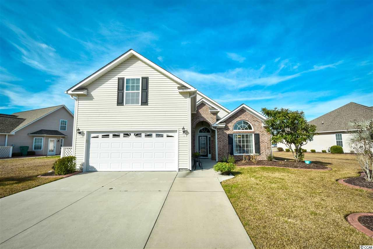 A beautiful and well maintained home located in the gated community Surfside Beach Club. This 4 bedroom 2 bathroom home is a short trip to the beach and Market Common. You walk through the foyer to enter into the spacious and open living room. The kitchen features upgraded cabinets, granite countertops with plenty of room, refrigerator, dishwasher, oven, microwave/range, and a breakfast nook. In the master bedroom you can find vaulted ceilings with a ceiling fan, a large walk-in closet, and an en suite bathroom. The master bathroom has double vanity sink with plenty of storage and a step in shower. Every bedroom features a ceiling fan and carpeting. Enjoy the screened in back porch that has a ceiling fan and tile flooring. Step outside where you can sit and take in views of the lake on the patio. The community has a clubhouse, Olympic sized pool, fitness center, and a very low HOA. Schedule your showing today!