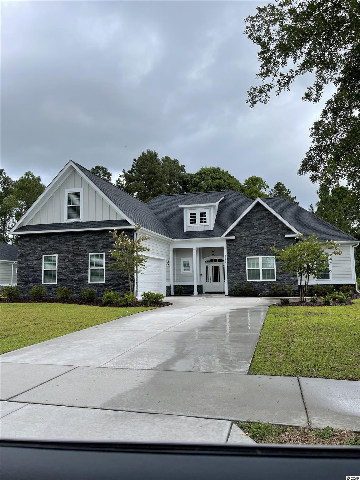 This beautiful new construction home is under construction and will be ready for a lucky buyer in April 2021! Located in the Wild Wing Plantation community that has a World class golf course and an amenities center that is amazing!. As you will enter this perfectly laid out open floorpan home with 4 bedrooms 3 bathrooms and a 5th room perfect for an office on the first floor. You will notice right away the upgrades and quality of work are above and beyond other larger builders in the area. This is a 100% custom home and it shows!. With LVP flooring throughout, Hardie board siding, upgraded countertops, tankless gas water heater, soft close all wood cabinets, all showers are tile including a large shower and tub in the master bathroom, custom wood shelving in your oversized master walk in closet, large tray ceilings, appliances credit will be given, crown molding and upgraded lighting package. This is a large private wooded lot on a quiet cul de sac street. Community has two entrances/exits which makes for easy access to all shopping, restaurants, medical facilities, Coastal Carolina University and two Highways for a quick drive to anywhere on the beach!. Buyers if purchase in time will be given choices for certain finishes. Pictures are of a completed similar home in the community. Book your showing today as you will not be disappointed!