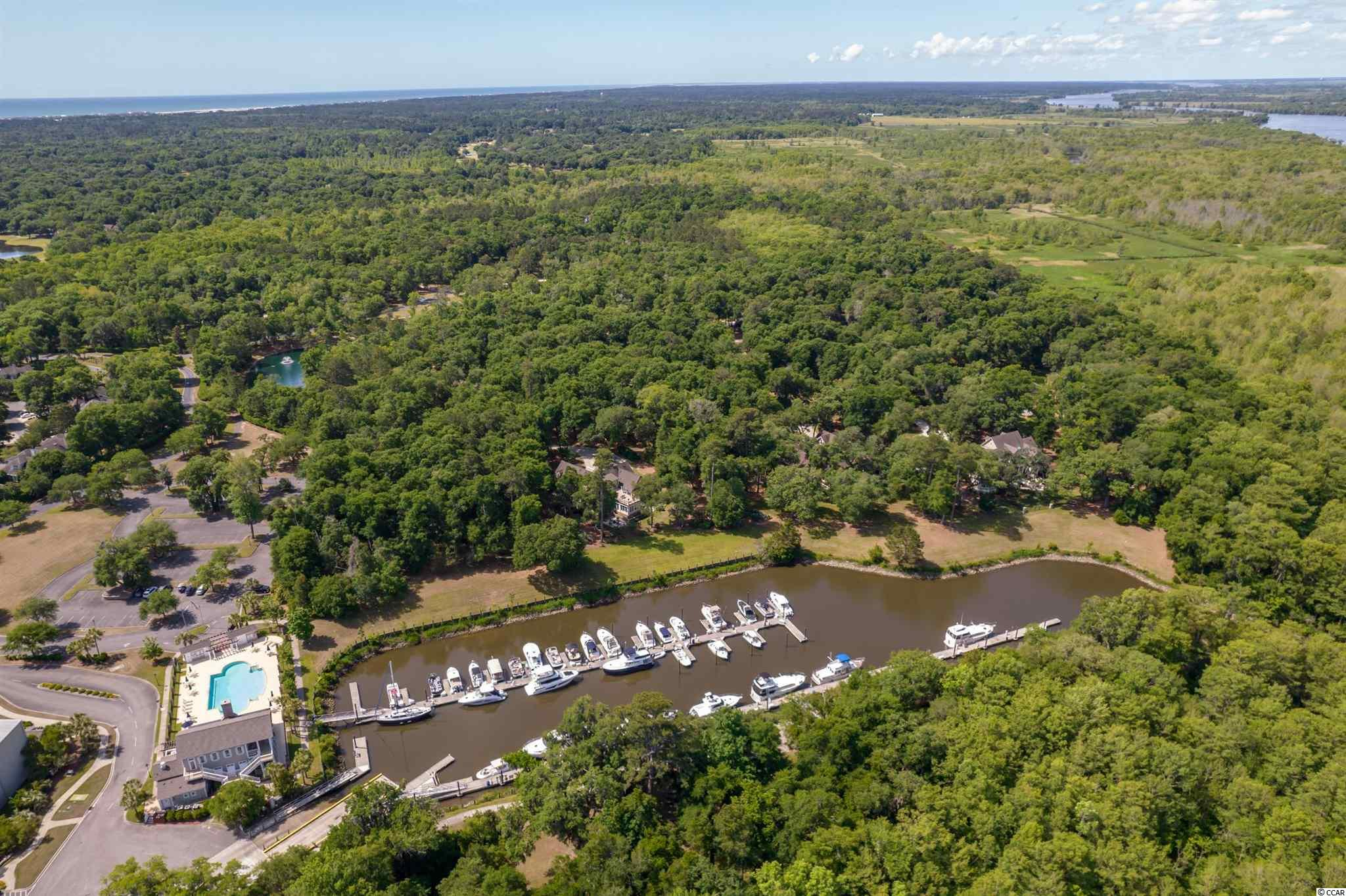 Located in the Island Estate section of the prestigious gated golf and marina community of The Reserve in Pawleys Island, this beautiful 1.45 acre marina-view cul-de-sac lot is ready for you to build your dream home!  Community amenities include 24-hour security, manned entrance gate, tennis courts, trails for walking and jogging, private beach access through the golf cart path and ride to Litchfield by the Sea and all of their amenities, with optional membership to the Members Club, marina and golf course. Membership to the private Reserve Harbor Yacht Club includes access to swimming pool plus dry storage for your boat, wet slips and deep water access for larger boats – all just a short golf cart ride away! The Reserve Golf Club features a Greg Norman golf course and fine dining. Close to all amenities that the Pawleys Island area has to offer.