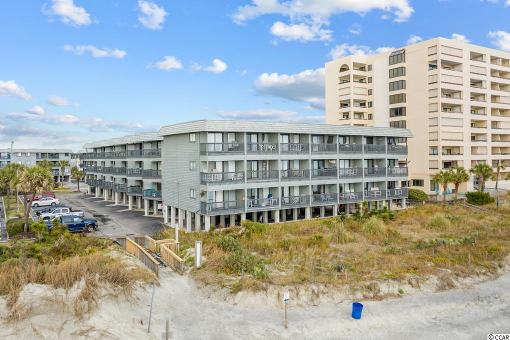Don't miss the quaint 2 bedroom ocean view condo in an oceanfront building in the ever popular Sea Cabin community in Cherry Grove.  This cheerful condo features 2 good sized bedrooms, and eat in kitchen and a great porch with views of the private community pier and ocean.  There's a community pool and this unit is a top floor condo meaning no one above you!  The beach in front of Sea Cabin is one of the larger sandy beach area in Cherry Grove.  You owe it to yourself to check this one out today.