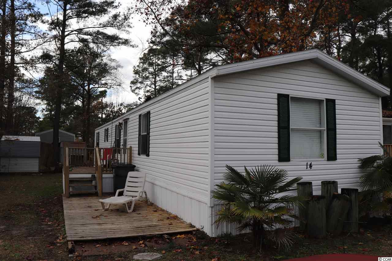 Windjammer Village is conveniently located in Garden City Beach, South Carolina minutes to beach access.  Homeowners may have golf carts and motorcycles, and enjoy swimming in the community pool on warm spring and summer days.  This home has a split three bedroom two bath floor plan and spacious living area that opens to the kitchen.  This home has a detached storage shed located in the back to enable ease of storage for beach equipment and extra storage.  Schedule a showing today! All measurements and square footage are approximate and not guaranteed. Buyer is responsible for verification.