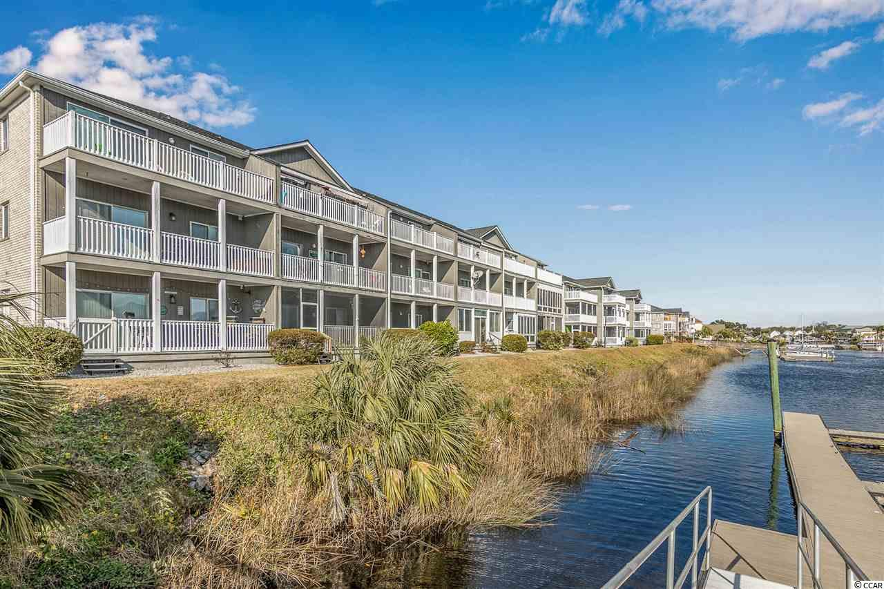 Handyman special! Excellent opportunity to own a 3 bedroom 2 bath condo on the FIRST FLOOR! DIRECTLY ON THE INTRACOASTAL WATERWAY. Carolina Yacht Landing is a gated community that allows short term rentals. Pool/Hot Tub, boat storage, day docks, private boat slips, gazebo, grills and beautiful views! Located near great schools, hospitals, championship golf, shopping, dining and only 5 minutes to THE BEACH! Schedule your tour TODAY!