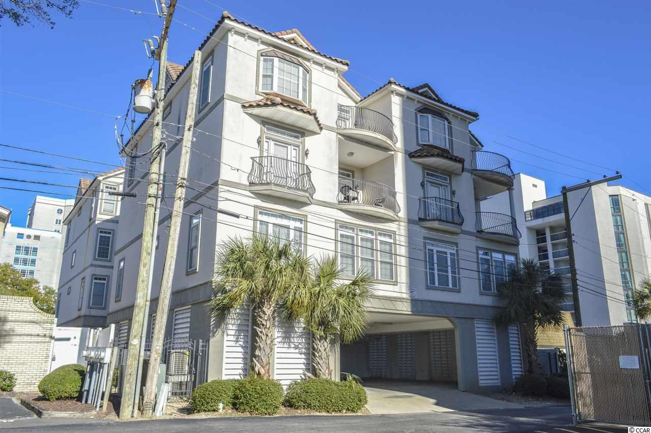 INVESTOR SPECIAL east of Ocean Blvd with strong rental history. 8 bedroom 8 bathroom, three-floor villa with interior and balcony views of the ocean (sleeps 16-20). Situated in a quieter, upscale, northern section of Myrtle Beach amid private dwellings. 125 YARDS TO THE BEACH. Perfect location for accessing the entertainment/amenities of both Myrtle Beach and North Myrtle Beach. Close to an abundance of shopping and dining options - perfect for family vacations, golf retreats, sport teams, etc. Covered under building private parking for 4-5 cars, private egress, fenced and tree surrounded patio. Common area includes a shared outdoor pool and large hot tub. PRIVATE ELEVATOR access from garage to all floors. First floor features 3 bedrooms, 3 bathrooms, recreational room with pool table, and kitchen with stainless steel appliances and granite countertops. Second floor has 2 bedrooms (including luxury master bedroom), 2 bathrooms (includes master bathroom with ceramic tiled walk-in shower, garden tub, and dual raised sink bowl vanities), large living room, and dining room area. Second floor is also equipped with an oversized gourmet kitchen featuring granite countertops, stainless steel appliances, work island, and pantry. Third floor has 3 bedrooms, 3 bathrooms, laundry room (with full size washer/dryer) and living room. This property must be seen to be appreciated - lots of upgrades like crown molding, recessed lighting, ceramic tile & wood flooring throughout! Perfect property for a 1031 exchange. Priced under recent appraisal value and will not last long, don't miss your chance before it's too late!