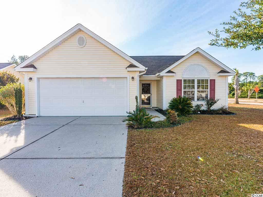 This neighborhood of Walkers Woods is located in the sought after Carolina Forest area of Myrtle Beach. Award winning schools, shopping, dining and the sparkling Atlantic are just a few moments away. There is a community pool for residents to enjoy as well as miles of walking and running paths, that are adjacent to this home.This home is located on a large corner lot and has wonderful lake views. This home is move in ready with fresh paint throughout and brand new carpet. Upon entering you will immediately notice the vaulted ceilings that give the home an open and airy feeling. The open floor plan flows smoothly from the great room to an open kitchen that is perfect for entertaining. Adjacent to the great room is a Carolina Room that overlooks the backyard water feature, complete with fountain. Exiting the sliding Glass doors you are in an enclosed private courtyard that can be enjoyed year round due to our temperate climate. The Master Suite features a walk in closet and Laminate Hardwood Floors, The master bath has both a soaking tub as well as a separate shower. The additional 2 bedrooms share a full bath.