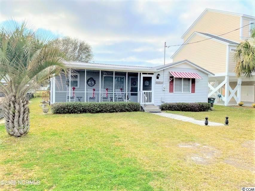 Wonderful traditional style beach house! 2 bedroom 2 bath. 50x100 lot. Recently updated with new granite countertops and plank flooring. New metal roof, front porch, back deck and home interior has been recently repainted. Has storage building in back yard. Only 1 1/2 block walk to the strand! Awesome location! In walking distance to everything almost or at least a short golf cart ride to beach, restaurants and shopping plazas! Publics, Hobby Lobby and much more! This home is sitting in a wonderful neighborhood! Three words... Location Location Location!!Perfect hide away! Call agent today!