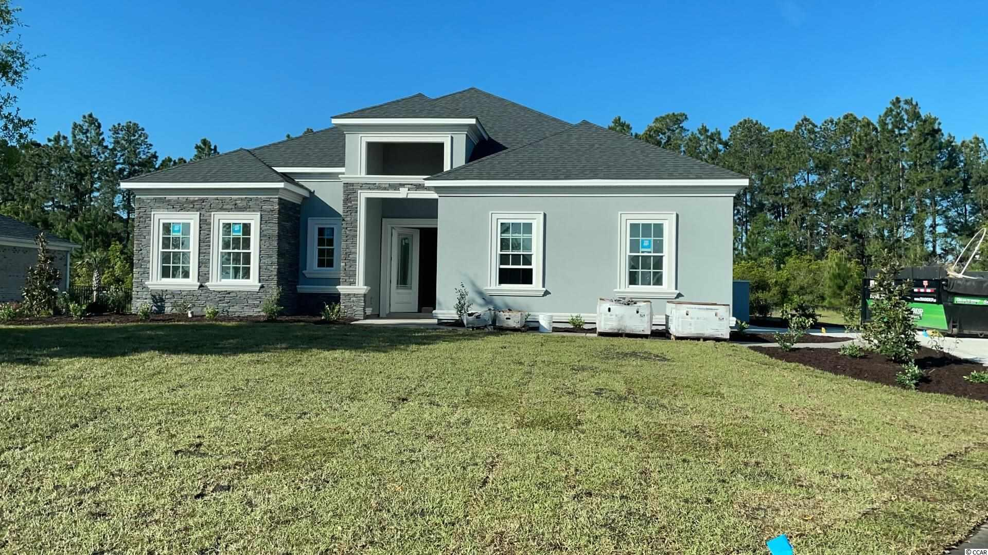 This beautiful new construction home is under construction and will be ready for a lucky buyer in June 2021! Located in the Wild Wing Plantation community that has a World class golf course and an amenities center that is amazing!. As you will enter this perfectly laid out open floorpan home with 4 bedrooms 3 bathrooms you will notice right away the upgrades and quality of work are above and beyond other larger builders in the area. This is a 100% custom home and it shows!. With LVP flooring throughout, stucco exterior, upgraded countertops, tankless gas water heater, soft close all wood cabinets, all showers are tile including a large shower and tub in the master bathroom, custom wood shelving in your oversized master walk in closet, large tray ceilings, appliances credit will be given, crown molding, upgraded lighting package and a outdoor built in natural gas BBQ area!. This is a large private lot with woods/water access to the large lake in Wild Wing. Community has two entrances/exits which makes for easy access to all shopping, restaurants, medical facilities, Coastal Carolina University and two Highways for a quick drive to anywhere on the beach!. Buyers if purchase in time will be given choices for certain finishes. Pictures are of a completed similar home in the community. Book your showing today as you will not be disappointed!