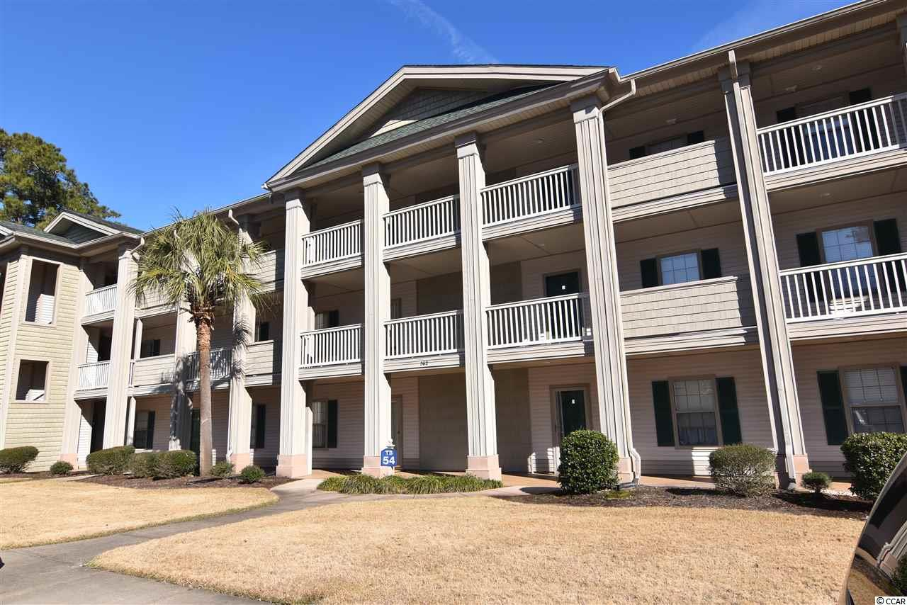 """This adorable, recently upgraded, fully furnished 2 bedroom, 2 bath condo is on the third floor, sleeps 6 comfortably, and has a fantastic view of the 1st hole of True Blue Golf Course.  Golf Magazine ranked True Blue & Caledonia Golf Resort (sister course) """"2019 Top 100 Resorts in North America for Buddies Trips"""". Great unit for families- the beach is 2 miles away, or as an investment- short term rentals allowed. The resort has 5 pools on property, golfing opportunities, as well as dining at both courses! Located in the heart of Pawleys Island which is a quick drive to the airport, the Historic City of Georgetown, Charleston, or Marshwalk in Murrells Inlet.   Did I mention this is an end unit? Light filters throughout the living, dining, and kitchen areas especially with the vaulted ceilings. Recent upgrades include laminate flooring throughout unit, new neutral paint throughout, new stainless steel appliances, new stackable washer/dryer unit, new toilets in both bathrooms, new bathroom vanities, new lighting throughout, new hardware throughout, new electronic combo front door lock with ability to set temporary codes, and a new electronic Ecobee thermostat. This unit is turnkey for you to start enjoying beautiful Pawleys Island."""