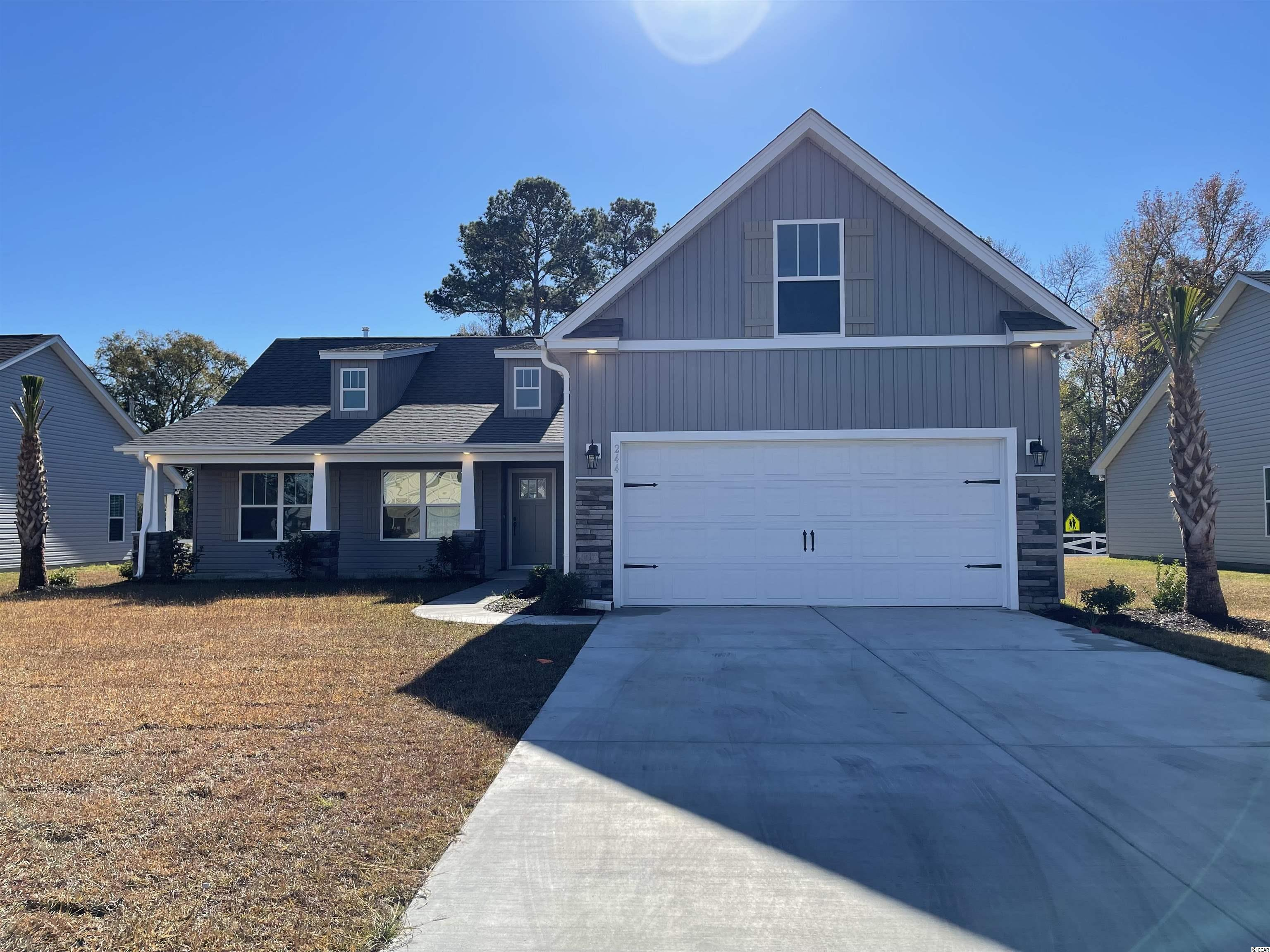 """Natural Gas quiet community located in Little River/North Myrtle Beach only a few miles from the Beach and major shopping! This is the Diamond floor plan featuring 4 bedrooms, 3 baths. This home includes finished 2 car garage, and a covered rear patio!! open concept floor plan, granite kitchen countertops, crown molding on kitchen cabinets with hardware included. 5ft cultured marble shower and a soaking tub in Master bathroom, walk in master closet. Ceramic tile in all bathrooms and Laundry room, LVP flooring in Family Room, Foyer, Hall. Vaulted ceiling in Family room and Master bedroom. Wainscot and 5 1/2 """" beaded baseboards for Custom look!! Home also includes TAEXX pest control tubing, lawn irrigation and Ring video doorbell!!!Stone accents on the exterior as well. All measurements are approximate *Photos of a similar home* Some items on the photos may be an additional cost. Anticipating completion in Fall 2021."""