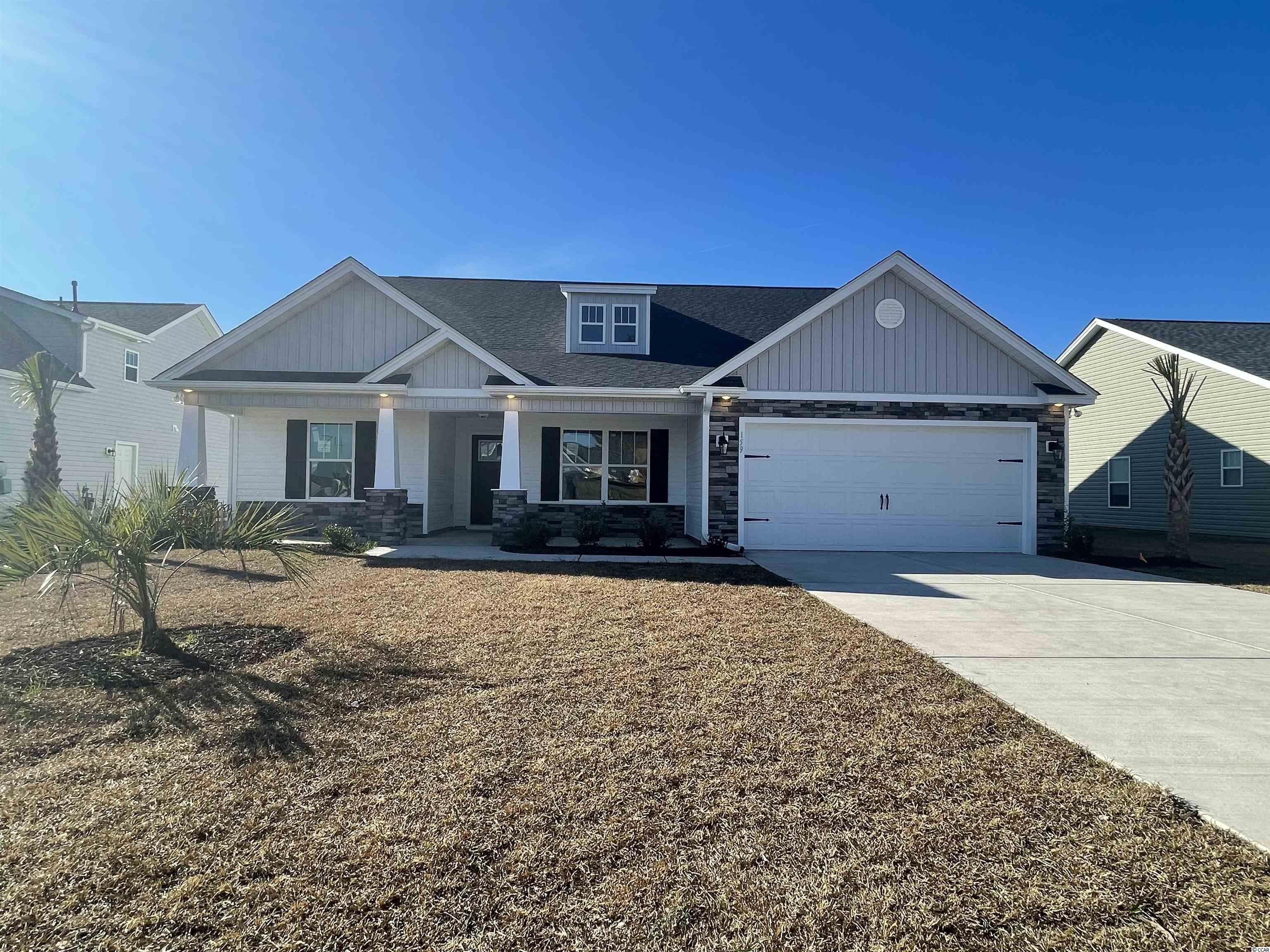 """Natural Gas quiet community located in Little River/North Myrtle Beach only a few miles from the Beach and major shopping! This is the Aquamarine floor plan with Bonus room and full bathroom above garage. Open floor plan on a 0.20 ac home site featuring 4 bedrooms, 3 baths includes a finished 2 car garage. Formal dining room and breakfast nook. Cultured marble shower and tub in Master bath. Ceramic tile in all bathrooms and Laundry room, LVP flooring in Family Room, Gallery, Foyer, Hall, Study, Breakfast Nook. Granite Kitchen Countertops, crown molding on kitchen cabinets with hardware included. Vaulted ceiling in Family room, Master bdr. Wainscot and 5 1/2 """" beaded baseboards for Custom look!! Home also includes TAEXX pest control tubing, lawn irrigation and Ring video doorbell!!! Stone accents on the exterior as well. All measurements are approximate *Photos of a similar home* Some items on the photos may be an additional cost. Anticipating completion time Fall 2021"""