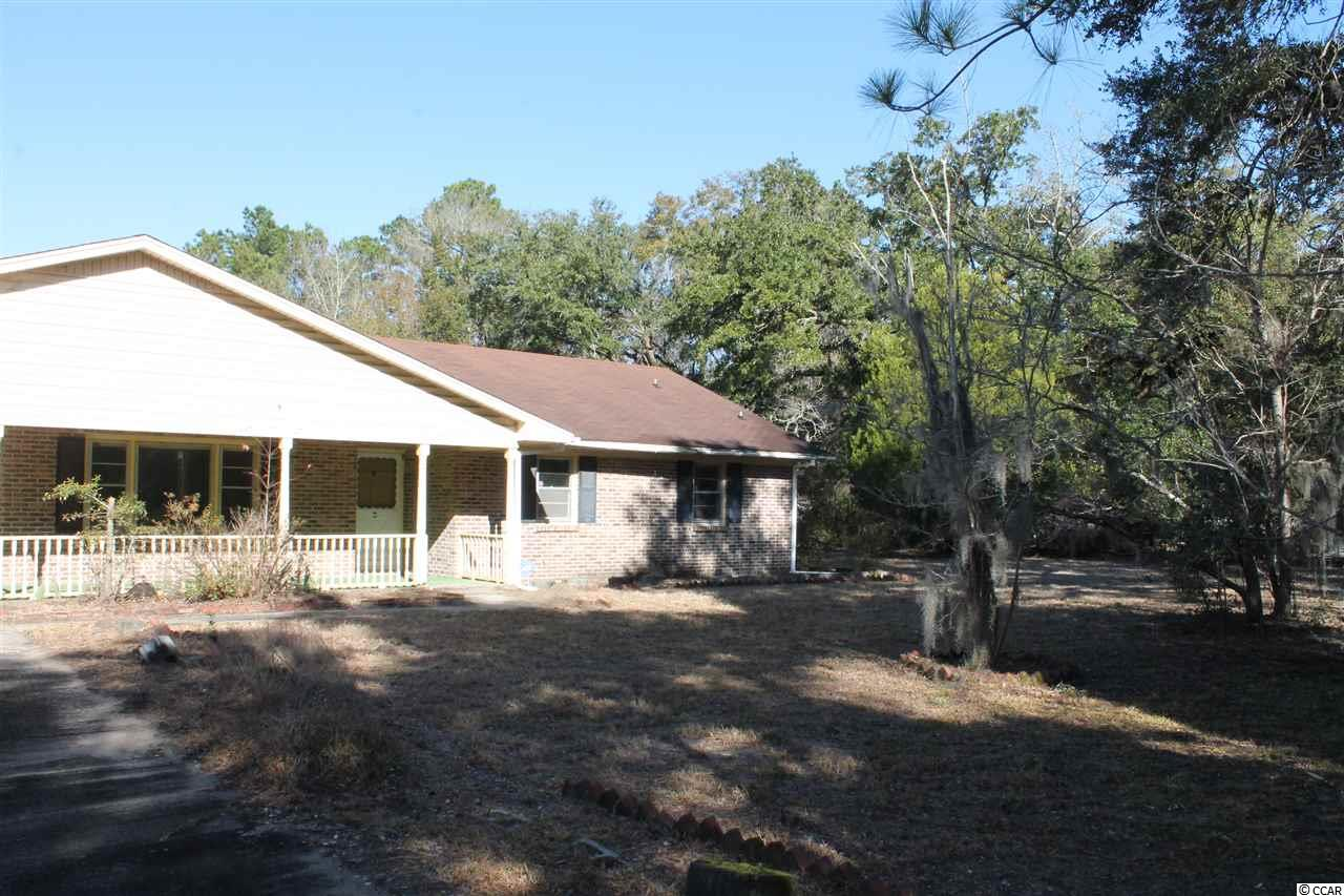"Bank owned property located on 1 acre lot. This is a true fixer upper with great potential. Home is being sold ""As Is"". If you are looking for a starter home, investment or fixer upper, then this is a must see."
