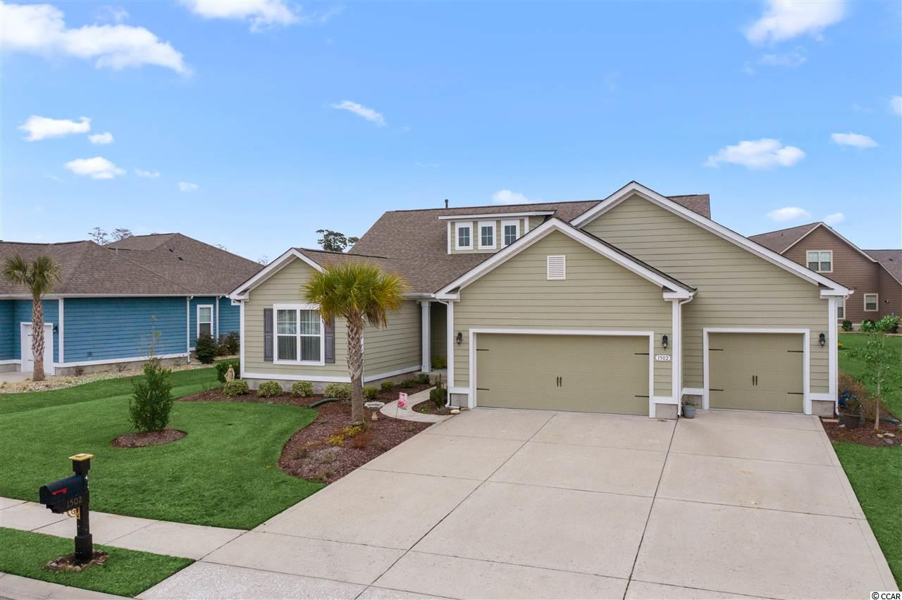 """BEST of BOTH WORLDS in North Myrtle Beach! Are you looking for ground floor living, yet you still want to be close to the BEACH? This 3BR/2.5BA/3CG Home in SEABROOK PLANTATION is located in a gated community, EAST OF HWY 17, walking distance to Coastal North Town Center (Publix, TJ Maxx, Dick's Sporting Goods, Hobby Lobby, Homegoods, Hickory Tavern, Panera Bread, etc.), & just a short golf cart ride to CHERRY GROVE BEACH. Built in 2017 by DR Horton, this lightly lived in home is as good as new! The front porch is welcoming & the entrance is elegant, featuring a tray ceiling in the Foyer. The large OPEN FLOOR PLAN is evident as you walk in, allowing for a true Family Room atmosphere. The Great Room includes 10' smooth ceilings, Natural Gas fireplace, Dining area, and a private Office space. The Custom Kitchen includes Stainless Steel appliances, granite countertops & tile backsplash, large pantry, work island, a breakfast bar & breakfast nook. The Large Master Suite features a tray ceiling, ceiling fan, Master Bath with double vanities, garden tub, tile shower, linen closet, and a LARGE Walk-In closet. Other interior features include: Screened back porch with tile floor, 3-CAR GARAGE, Mud Room with bench, Carpeted bedrooms, Ceiling fans, Crown molding, & Attic storage. Exterior features include: Hardie Board siding, Architectural shingles, Concrete patio, Rear entry door to garage, Irrigation, & Large driveway. Natural Gas supplies the Tankless Rinnai Water Heater, HVAC, & Fireplace w/blower. Neighborhood amenities include: gated entryways (3), clubhouse with swimming pool/spa, sidewalks, RV/Boat storage, and landscaped right of ways. Seabrook Plantation is gated """"golf cart friendly"""" community that is just a short ride away from anything CHERRY GROVE BEACH has to offer! Call an Agent TODAY for a showing. This is the ONLY home listed in the neighborhood at the moment."""