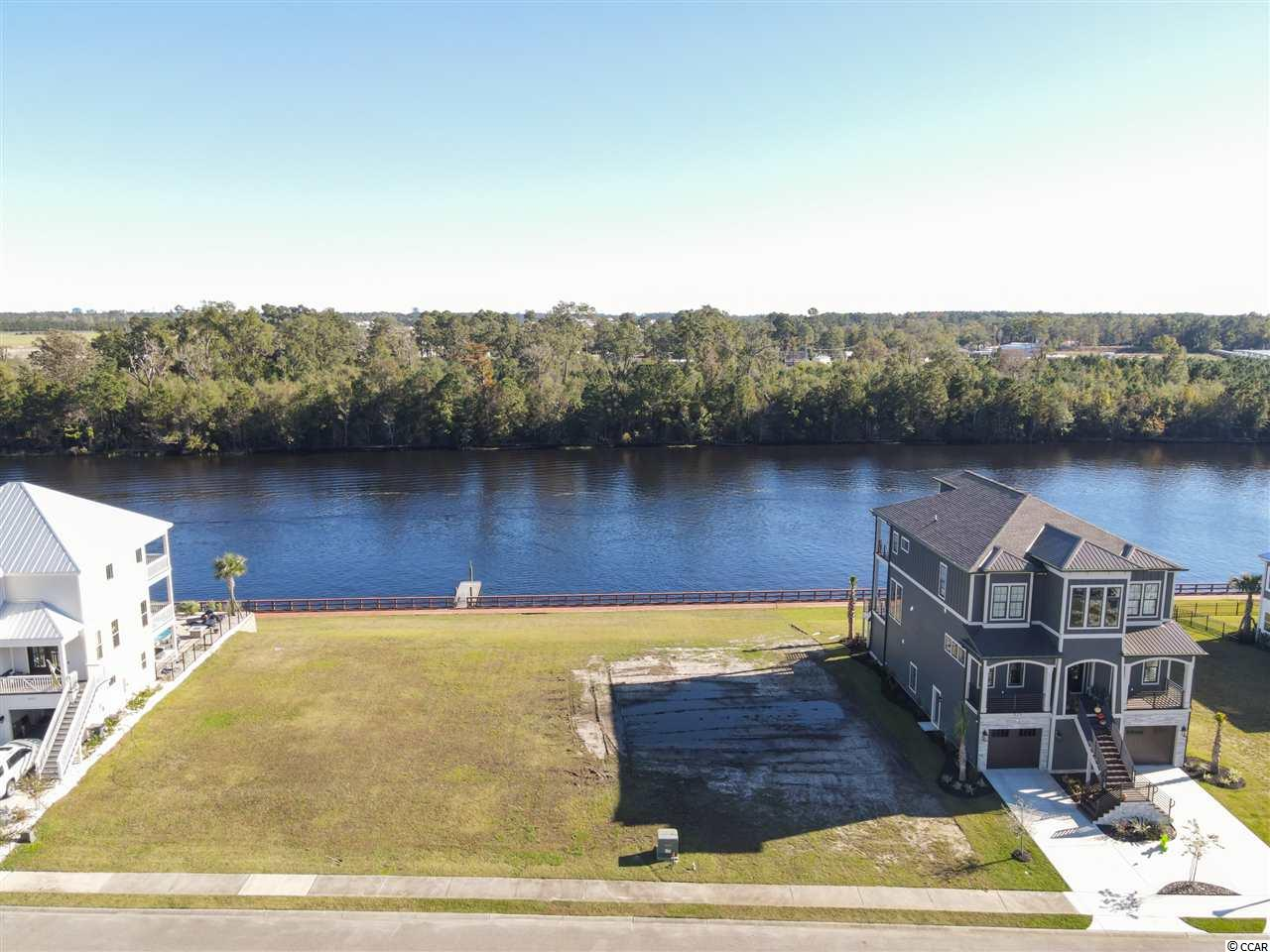 Intra Coastal Waterway lot for sale in the sought after community Boardwalk on the Waterway!. Conveniently located minutes to the airport, beach and all that Myrtle Beach and surrounding areas have to offer. Lot is located at the back of the community out of the flight path and less through traffic. Also located close to the private boat launch and storage area. These lots have been going up in price due to low inventory and priced thousands less than other Intra coastal waterway community lots in the area. Purchase now with no timeframe to build your dream home!