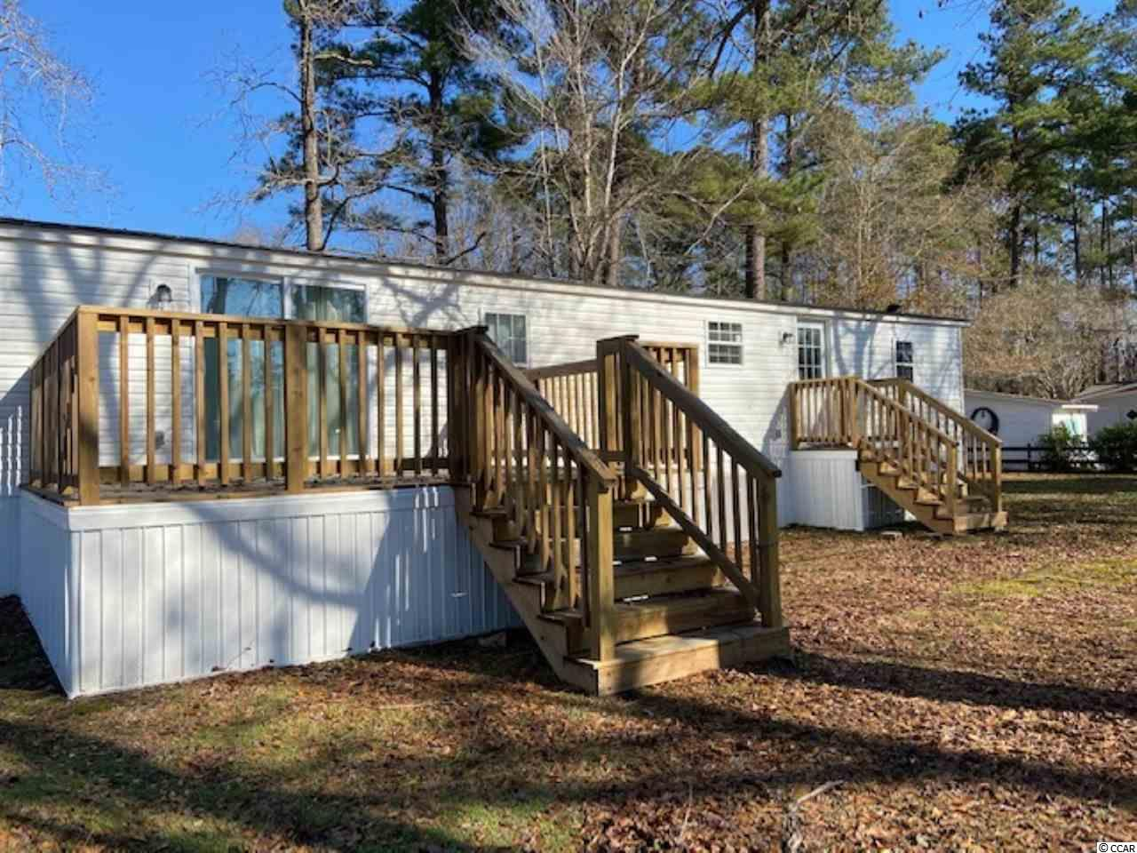 Beautiful recently renovated manufactured home situated on a great treed 1/3 acre lot .  Sit on your front or rear deck and enjoy the privacy of your yard. Over 1500 sf of living space with a large family room with a fireplace and view of the back yard and deck. Three good size bedrooms with split plan living quarters for guests. New stainless steel appliances, upgraded countertops & kitchen cabinets.  All new floors with plenty of closet space for storage, laundry room off kitchen with hookups. This quiet neighborhood is a few miles outside of the historic town of Conway and not far from the beach, shopping and amusements. This is a great getaway for your family vacations.  Don't miss this opportunity to own your piece of heaven!  ***Bonus - Seller purchased in June 2020 and paid land lease through July 2021 which will be transferred to new owner at closing by owner of Williamson Park.  Great location outside of downtown Conway close to the beach and amusements.