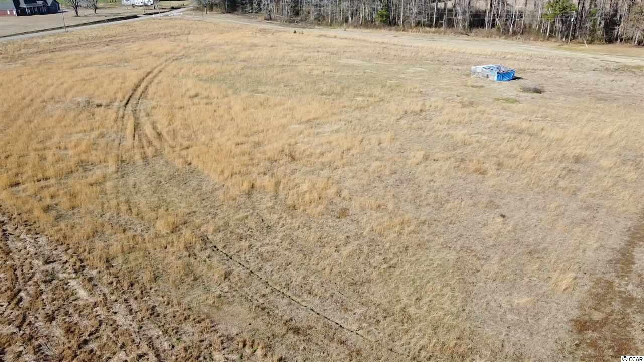 28.42 acres of vacant land that is mostly cleared.  Property includes an approximately 60'x30' building that has a bedroom, closet, full bathroom, and kitchenette.