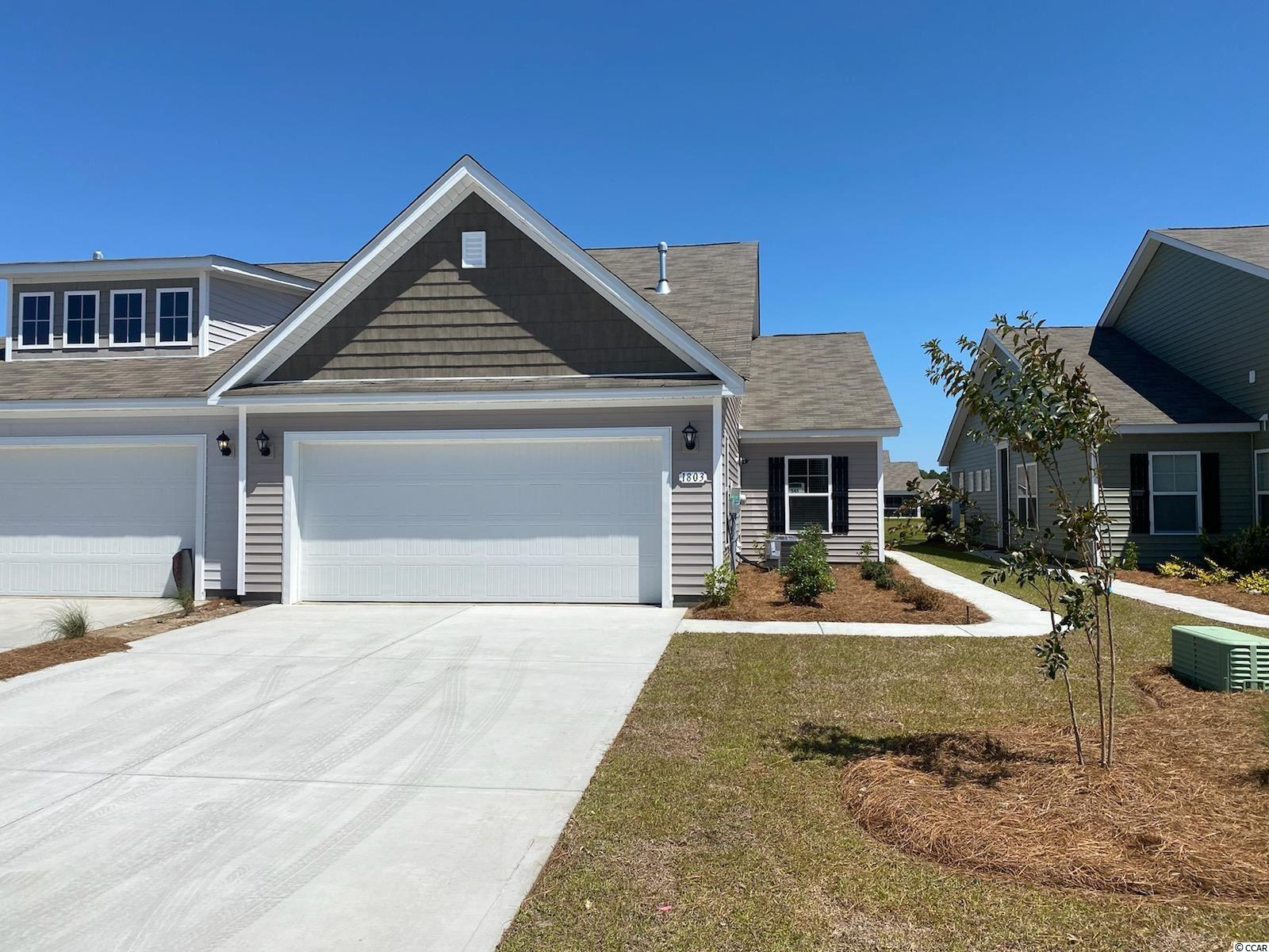Enjoy the laid back coastal lifestyle where all of your exterior maintenance is taken care of! A rare opportunity of a duplex being offered in Carolina Forest that also features an attached two-car garage. Upon entry you are greeted with a very open layout and high vaulted ceilings. The split bedroom floor plan offers privacy when you have guests visiting you at the beach, along with functionality. This home will also have a spacious rear covered porch with pond views that is great for morning coffee! Granite countertops, tankless water heater, white painted cabinets, and stainless appliances with a gas range all included. This is America's Smart Home! Ask an agent today about our industry leading smart home package that is standard in every home. *Photos are of a similar Tuscan home. (Home and community information, including pricing, included features, terms, availability and amenities, are subject to change prior to sale at any time without notice or obligation.  Square footages are approximate.  Pictures, photographs, colors, features, and sizes are for illustration purposes only and will vary from the homes as built.  Equal housing opportunity builder.)