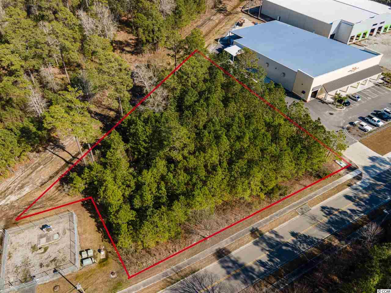 Wonderful opportunity to own almost a FULL ACRE of land in the heart of Myrtle Beach. This commercial site is has paved roads, water and sewer availability, no HOA and no timeframe to build! Bring your own builder to realize your vision of the perfect office complex, manufacturing facility or trade shop! Located near all major highways and the airport! Financing options available. Call today!