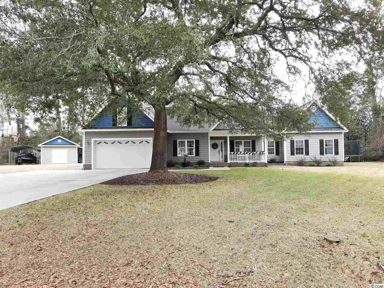 Stop looking, your forever home search is over. This sprawling home in Murrells Inlet meets every one of your needs and desires. Located on a quiet cul-de-sac , Johnson Circle (off Goude Street) is a non HOA community. The lot has plenty of room for any, and all the toys you have or want. Large front and backyard. Detached 16x24 shed/workshop with 3 lean-to's off the building. The oasis out of your backdoor features a 30x15 pool with a 10x10 tanning ledge along with a paver pool deck, and, firepit. The home has a wonderfully designed split floor plan. The master bedroom features his/her walk-in closets, double vanity, tiled shower, and, tub. The Kitchen features granite counter-tops, stainless appliances, and, a monster walk-in pantry. Large living room that opens into a Carolina Room overlooking the pool. There are 3 other 1st floor bedrooms with 2.5 bathrooms. Over the garage is a large finished bonus room. The attic space for this home will accommodate every single holiday decoration box , and , all of grandmas hand me downs, it's huge. Just for good measure on engineering, this home features a metal roof truss design, you hardly find that. This location and home offer the very best of Murrells Inlet living. Just a half mile from the Inlet, and, 2 miles to the Intracoastal waterway. Stop dreaming and start living.