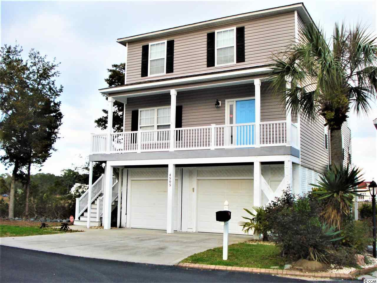 Stunning views of the marsh lands, the Intracoastal Waterway...Lets take a tour!!  This beautifully appointed four bedroom, three bath house sits in a most desireable Intracoastal Waterway community.  The open floor plan in the family room, dining area and kitchen lends itself to family gathering for activities together.  The kitchen has upgraded granite counter tops, appliances, a breakfast bar for extra dining space and a large dining area.  The great room joins both the kitchen and dining areas and is a comfortable size for the whole family with beautiful views of the marsh  complete with wild life birds etc to entertain the whole family from a wrap around porch to include enjoying the boat activity.  One bedroom is located on the main floor and has its own bathroom.  The laundry room was custom designed and is spacious.  The second level has two spacious bedroom with ample closet space and a full bathroom for convenience.  The master bedroom suite is very, very spacious and has it own private porch for enjoying views of the marsh and ICW in privacy; The mater bath has a jetted tub, double vanity and a shower.  The house has many upgrades to include: Two HVAC systems that are 2 years young; the vinyl siding was replaced two years ago; The duct work has a special system that prevents the growth  of mildew; EcoBee system allows complete control of both HVAC systems, garage doors via cell phone; all the porches/decks have been replaced with a composite material that resist rot, as well as the vinyl porch railings.....the exterior is basically maintenance free; there is crown molding for added beauty; all three toilets are one piece, no separate tanks for prevention of leaks; upgraded light fixtures; ceiling fans; gutters; parking for 5 cars with an oversized garage complete with storage: FEMA documents are in Associated  Docs-the house has never flooded.  Also, there are vent to allow water to flow through which would prevent water damage to house.  Security:  Gated community.  Also the house is protected by CPI Security System, RingDoor, as well as interior and exterior cameras that are monitored by  CPI and can be monitored by owner via cell phone.  This house is immaculate and inviting it has a dock for owners to enjoy fishing, socializing a day dock. This property has its own private boat dock with a hydraulic lift that comes with this house.  There is Cricket Cove Marina adjacent to the property and boat dock for gas and supplies for a day of boating!!! Get acquainted with the Little River, a quaint little fishing village which boasts some of the best restaurants along the South Carolina coast..superb italian, french, seafood, fine dining, steak and only three miles to the famous Calabash, noted for its seafood restaurants!!  If you are looking to enjoy coastal living....LOOK no more, it's here.