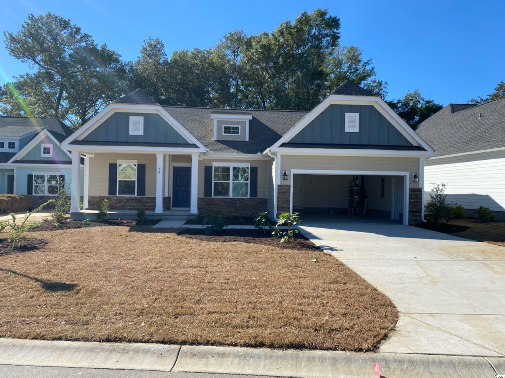 The wait is over for this new phase of Pawleys Plantation. This is a to be built plan with the standard features pricing that is ready for your input on the options and colors.  The home includes granite countertops throughout, 9 foot ceilings, crown molding and tall baseboards, lawn irrigation and much more! All measurements are approximate and can be verified by Buyers Agent/Purchaser. This home is a Wisteria E Model. Don't miss this opportunity to own the home of your dreams in Pawleys Plantation!